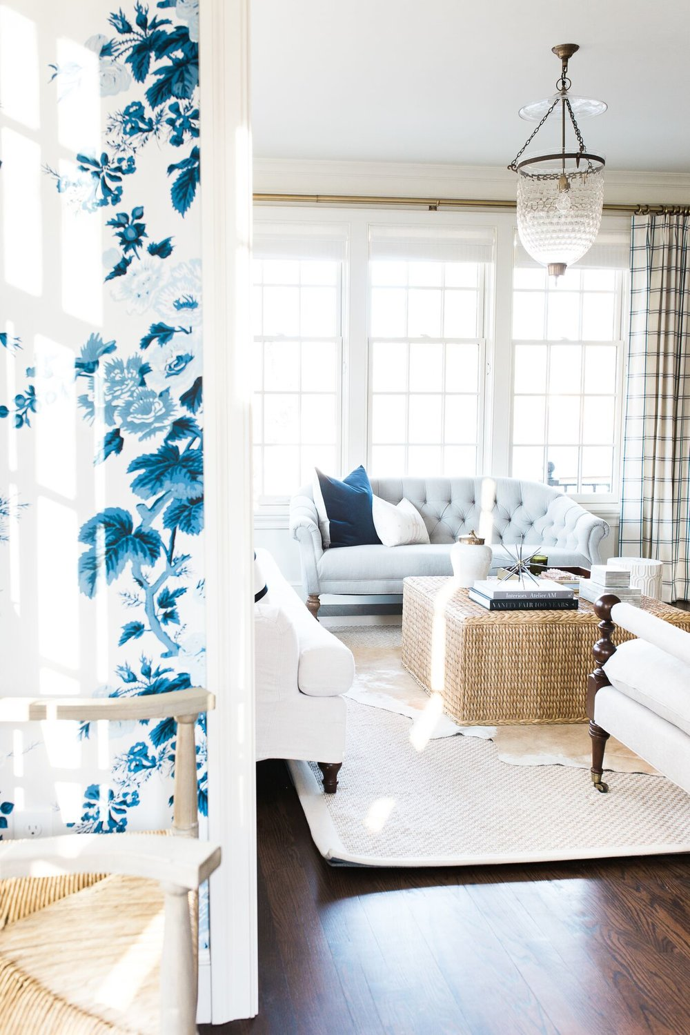 Beautiful wicker accent table with blue & white wall paper | via Studio McGee