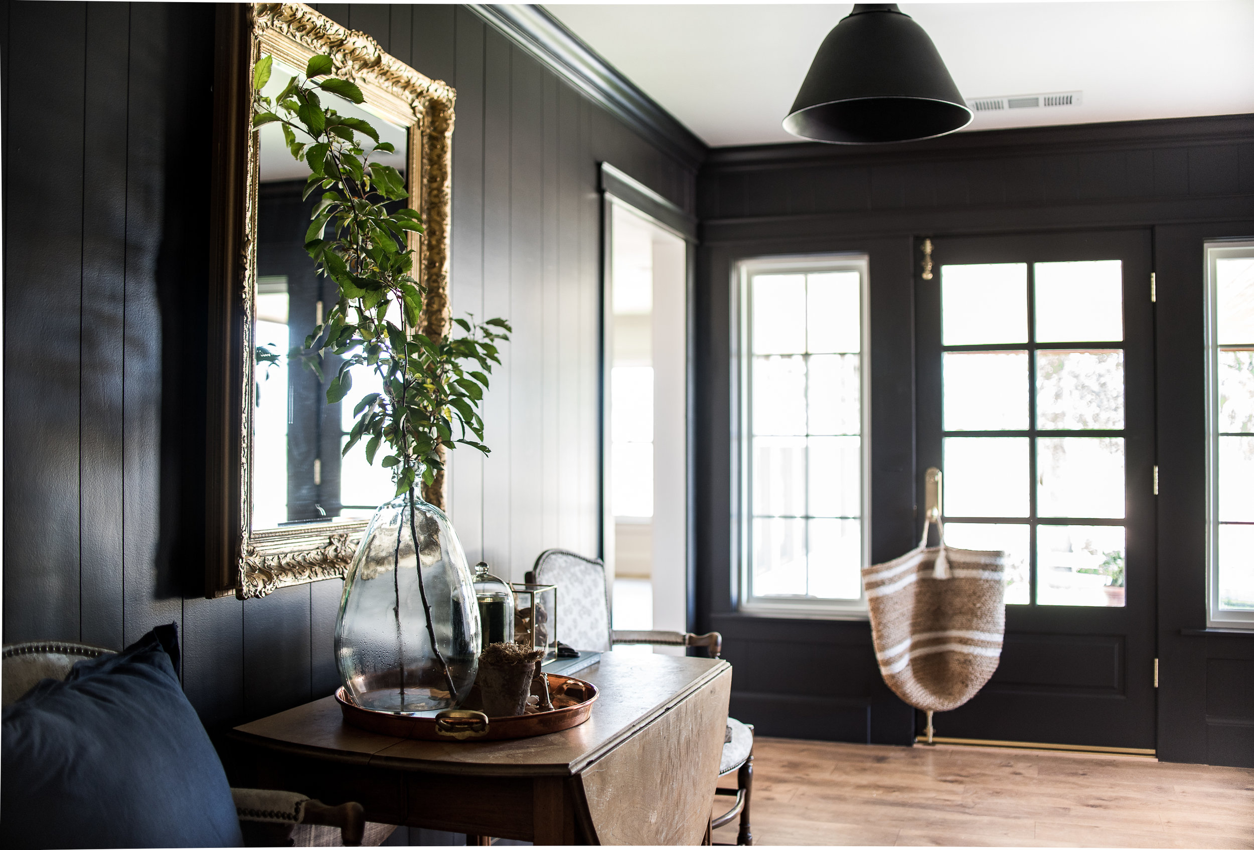 Black entryway with shiplap walls • antique furniture | boxwoodavenue.com