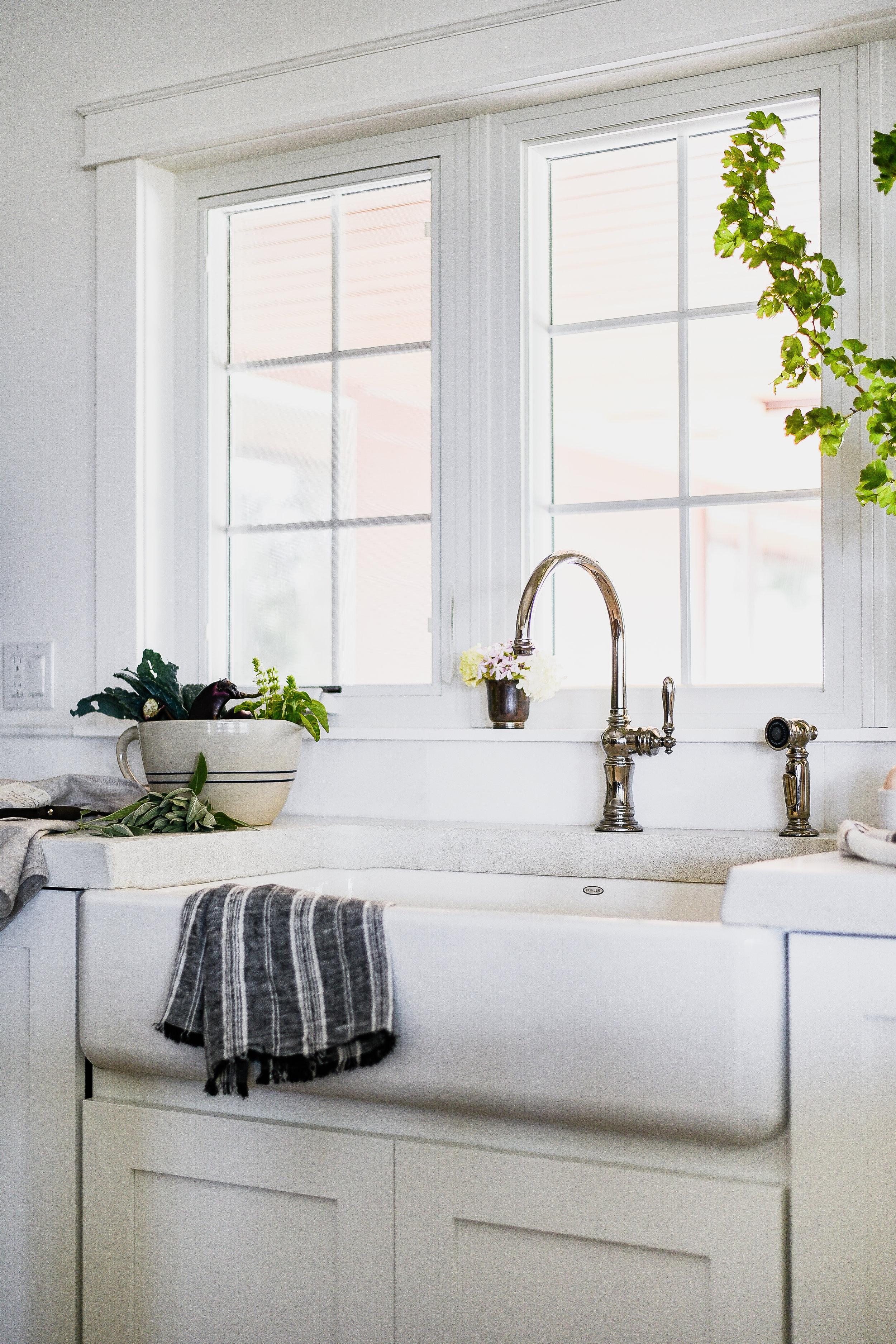 Farmhouse sink with antique faucet & concrete countertops | boxwoodavenue.com