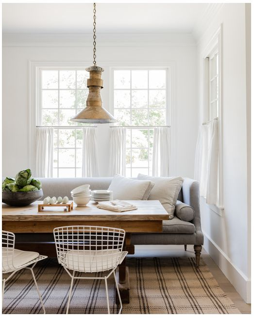 Vintage light fixture in farmhouse dining room