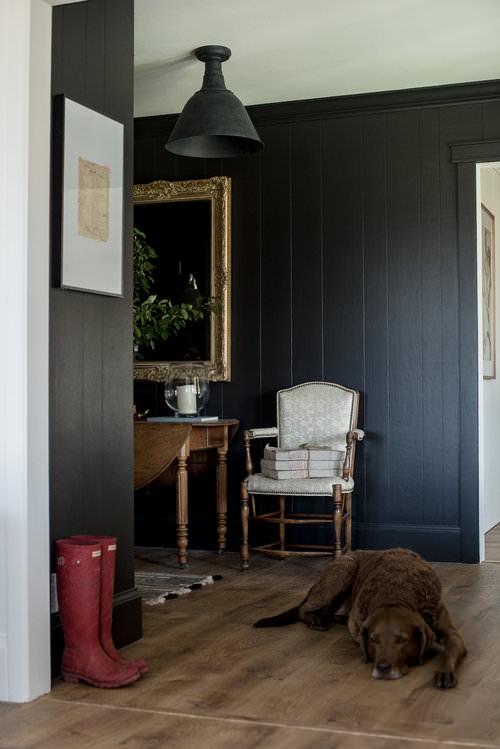 Black Entryway with Wood Paneling & wood floors   #farmhouse   boxwoodavenue.com