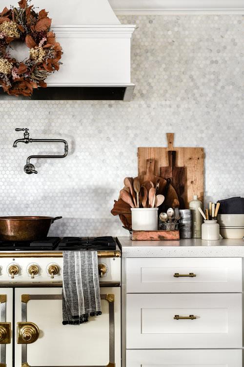 White Farmhouse Kitchen with Shaker Cabinets and La Cornue Stove | boxwoodavenue.com