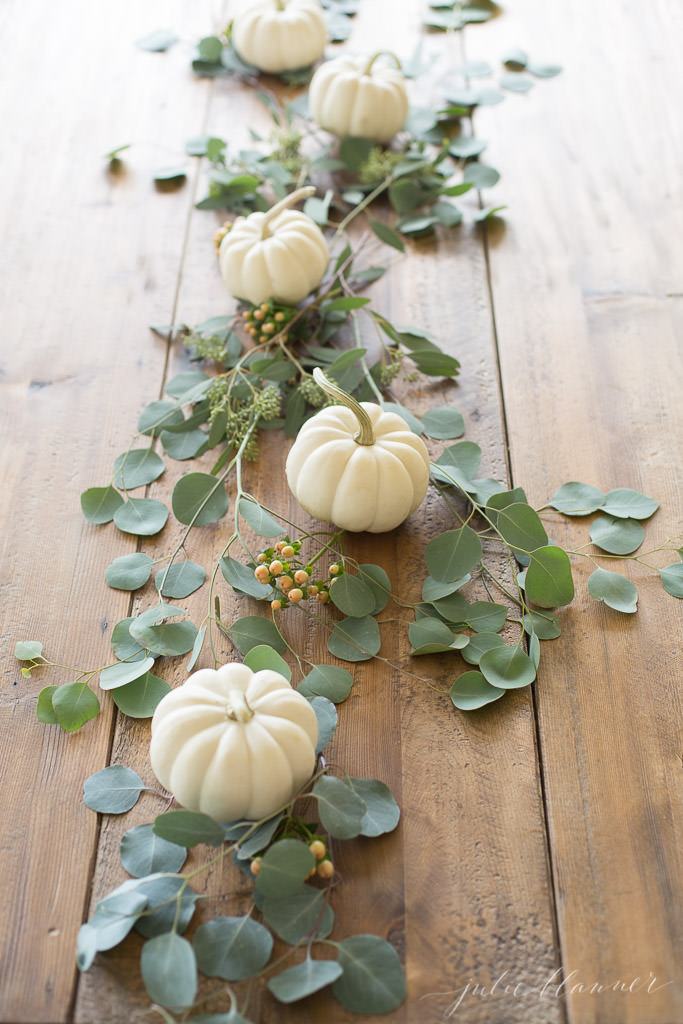 Mini Pumpkin Tablescape via Julie Blanner [20+ fall tabletop ideas]