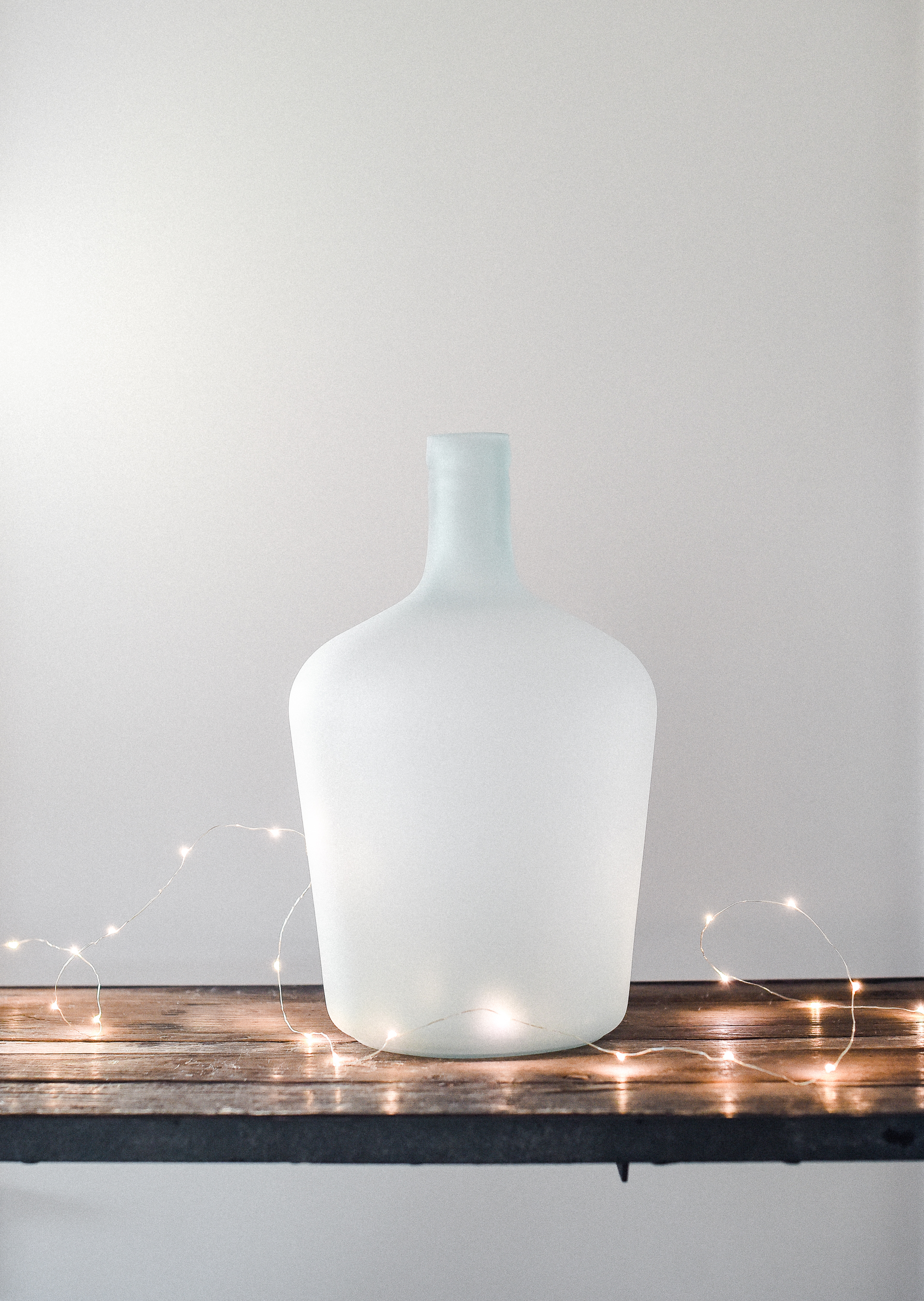 Farmhouse Christmas Ideas - Find new ways to jars, vases, and pitchers this holiday season to turn everyday farmhouse items into beautiful Christmas decor! I love adding twinkle lights or fresh clipped evergreen!
