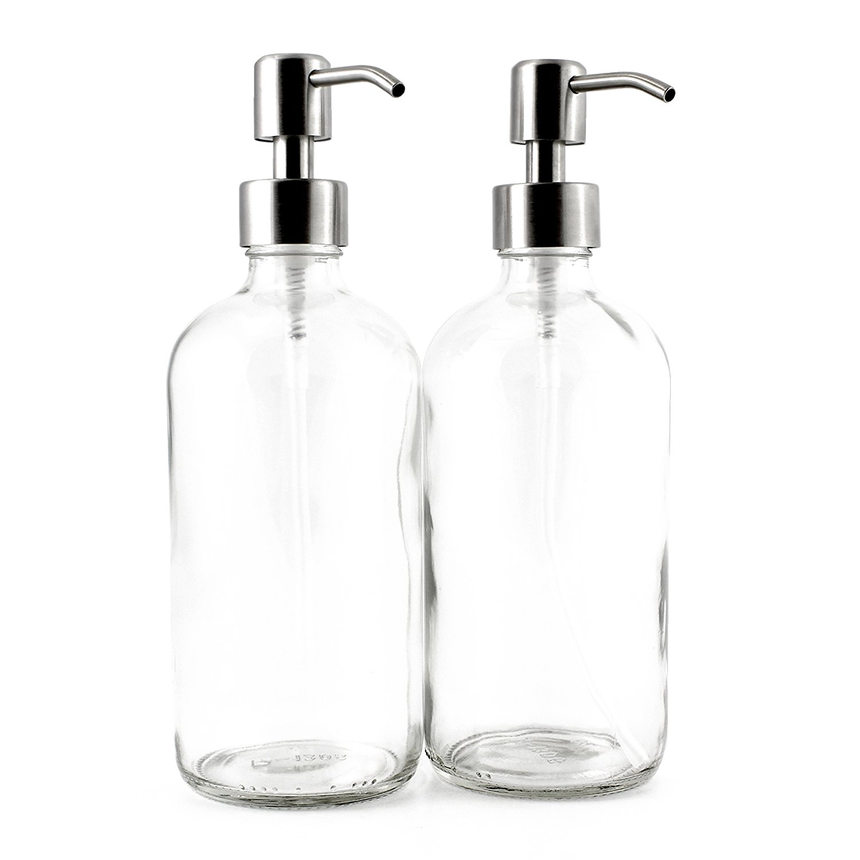 Green cleaning supplies empty glass bottles