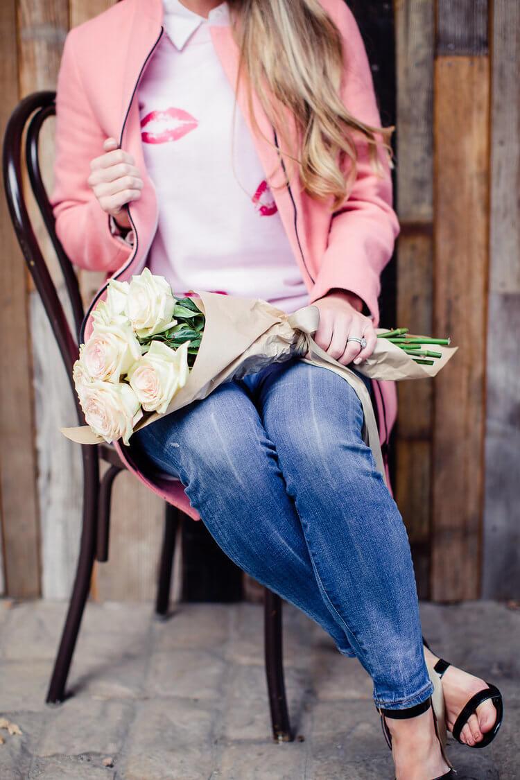 DIY Valentine's' Day sweater decorated with kisses using heat transfer vinyl (htv vinyl) and Cricut. #valetinesdaysweater #htvvinyl #cricut #DIY