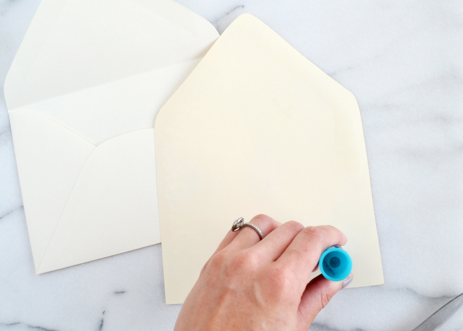 Such an easy way to upgrade envelopes! Great for weddings and parties. Learn how to make DIY Wedding Envelope Liners | BoxwoodAvenue.com #envelopeliner #diy #weddinginvitations