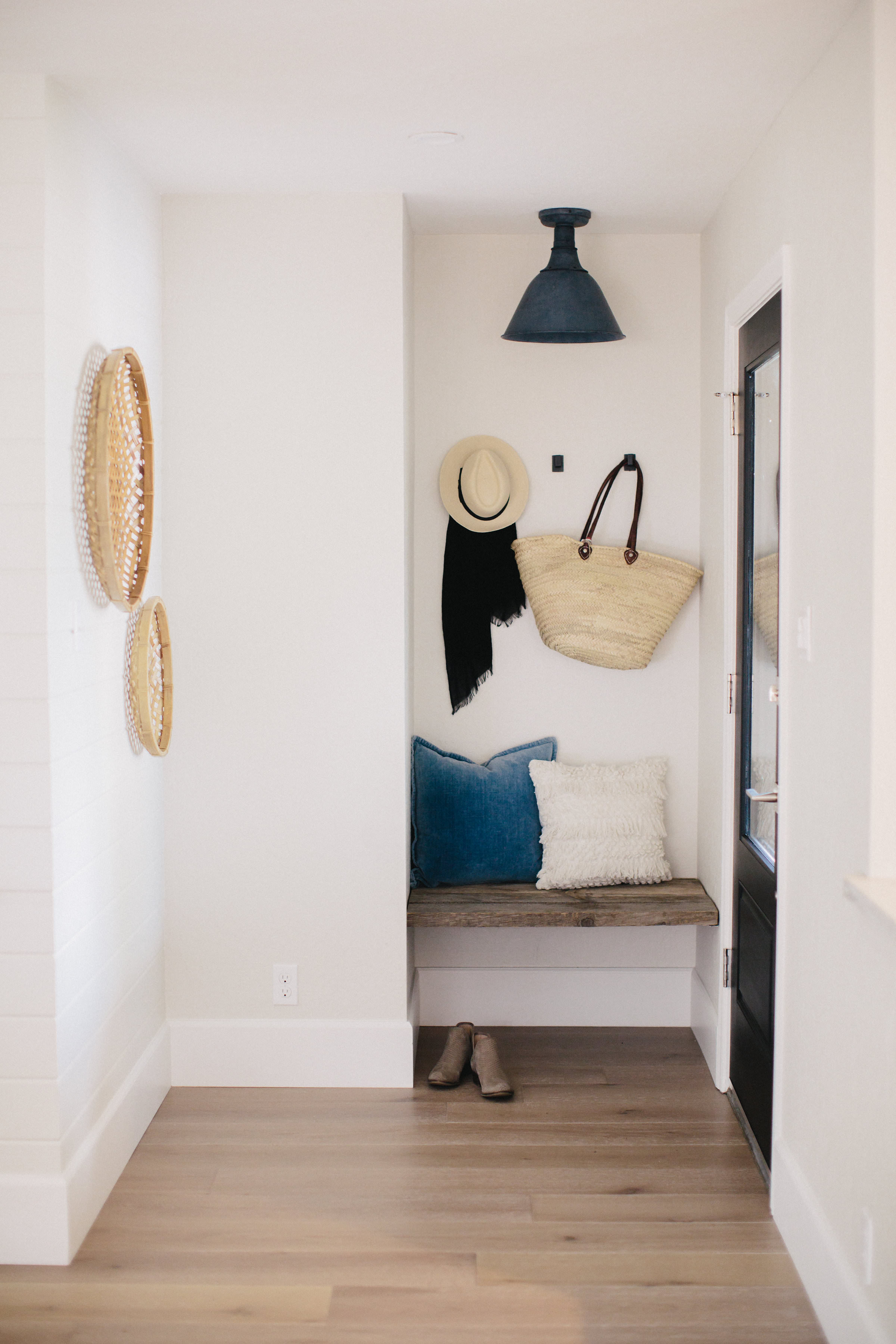Built-in bench in the entryway with weathered wood | boxwoodavenue.com #entryway #builtinbench
