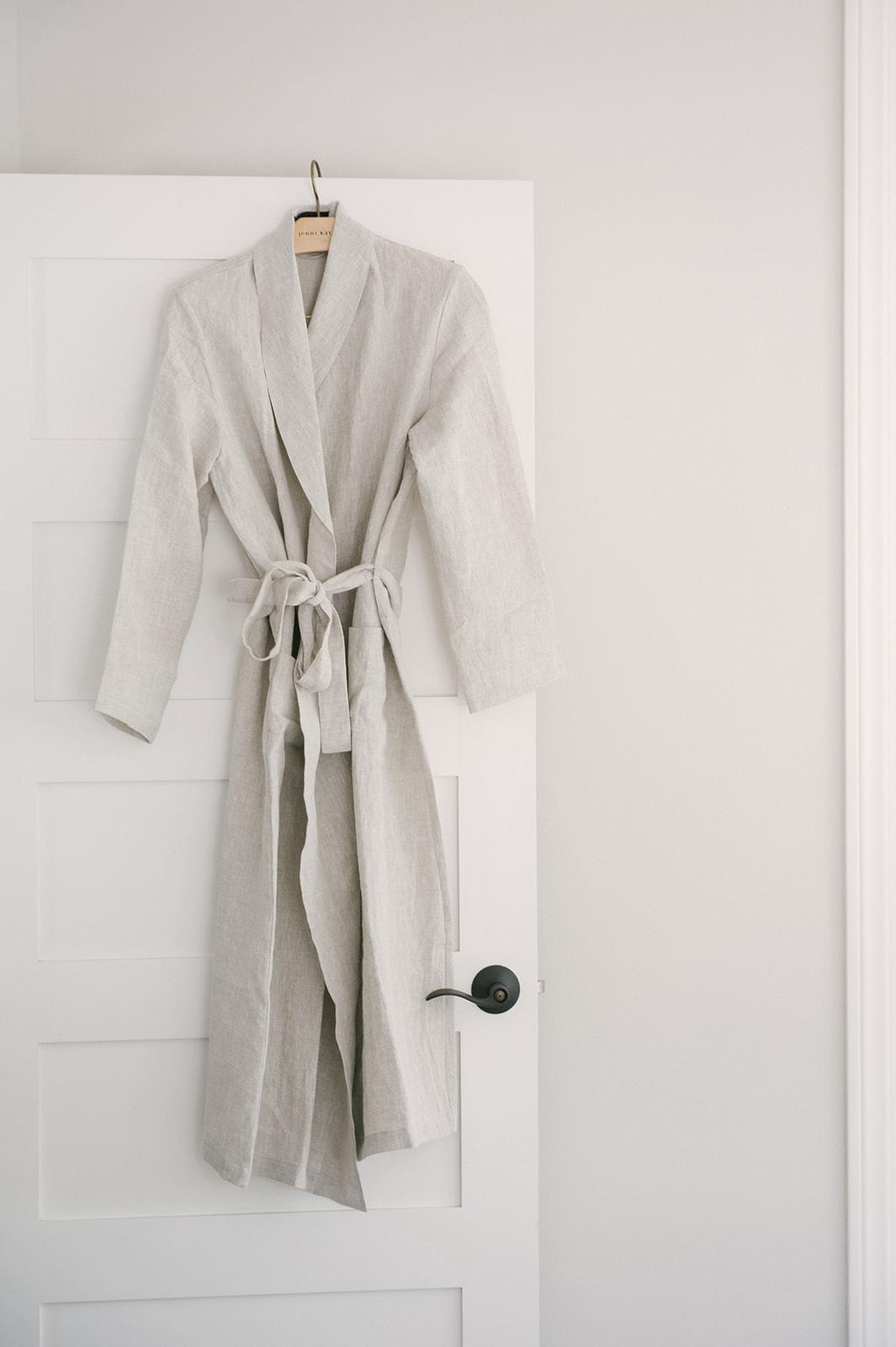 Jenni Kayne linen robe with gray wall backdrop