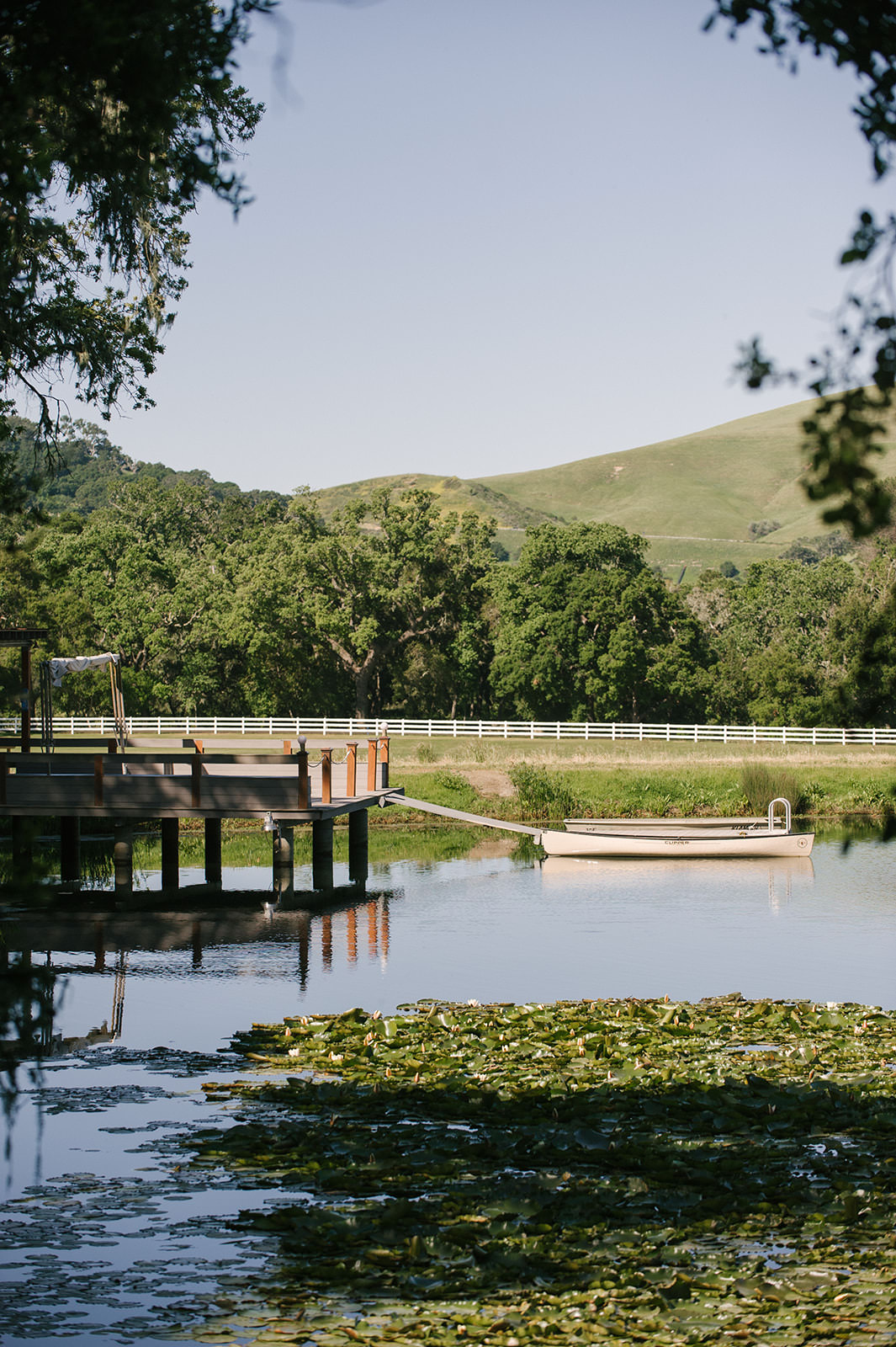 Gorgeous pond at farmhouse with canoe at dock | folded hills ranch in Santa Barbara California