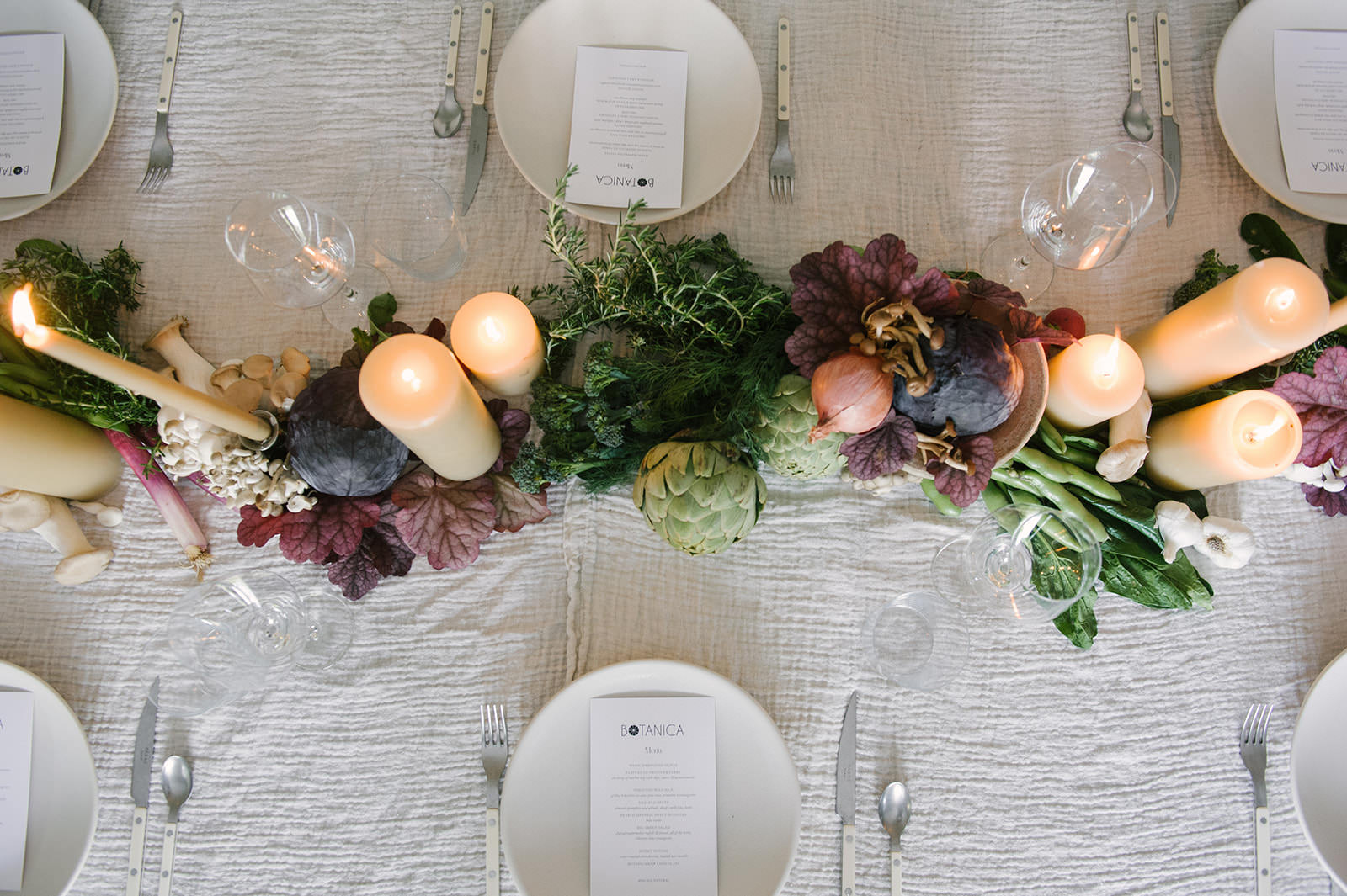 Beautiful vegetable table runner with candles and fall harvest. Such a great thanksgiving or fall tablescape idea!