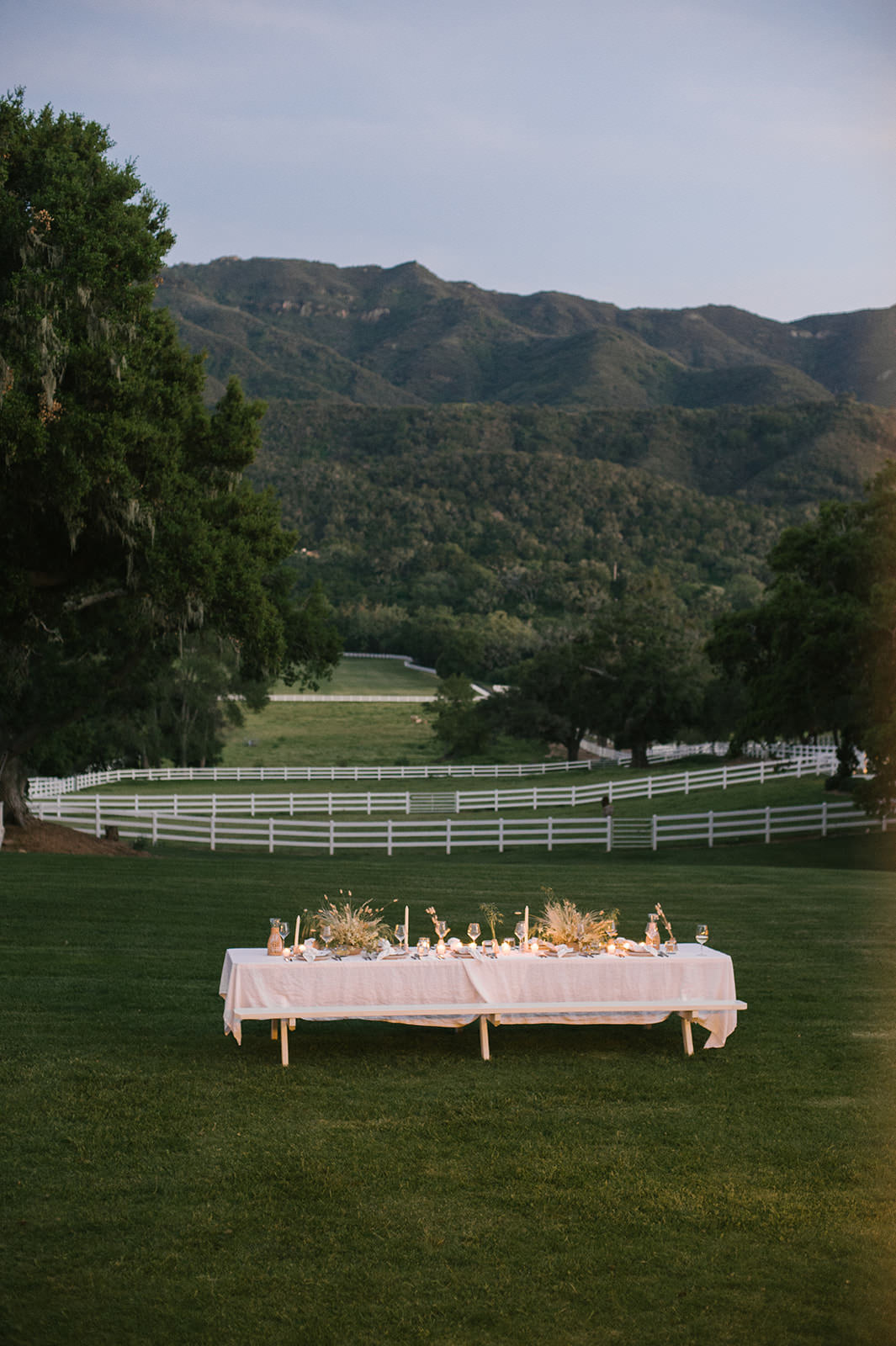 Beautiful white table at farm - summer #entertaining ideas by Jenni Kayne