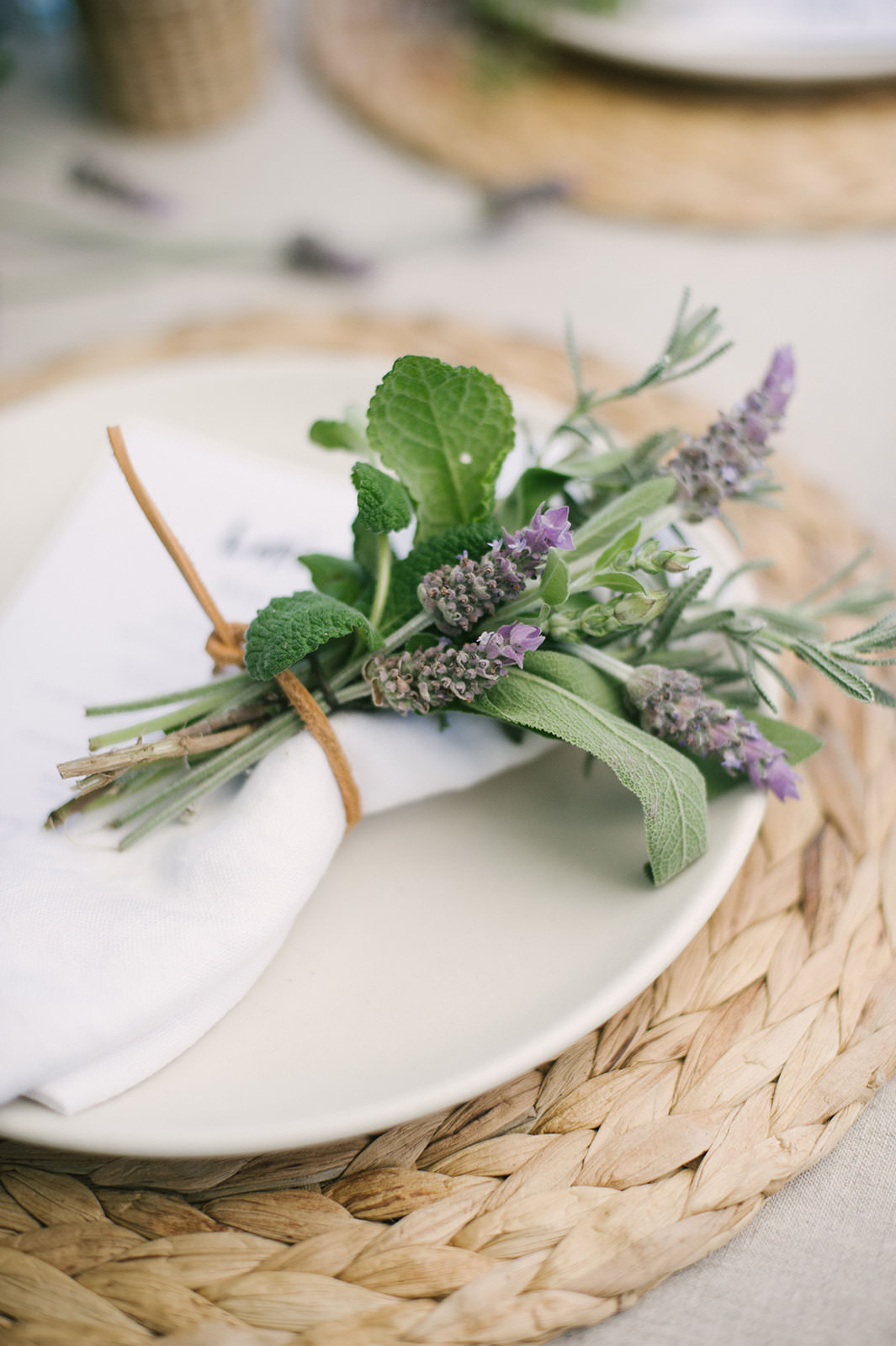 Bundle of herbs as table setting idea for #entertaining by Jenni Kayne