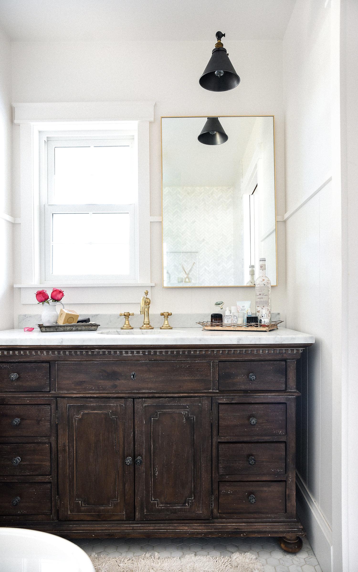 Marble+&+brass+bathroom+with+vintage+dark+wood+vanity+remodel.jpeg