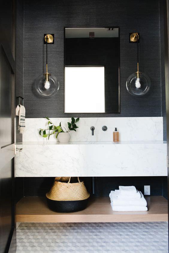 Beautiful black bathroom inspiration with marble floors and custom vanity by Studio McGee