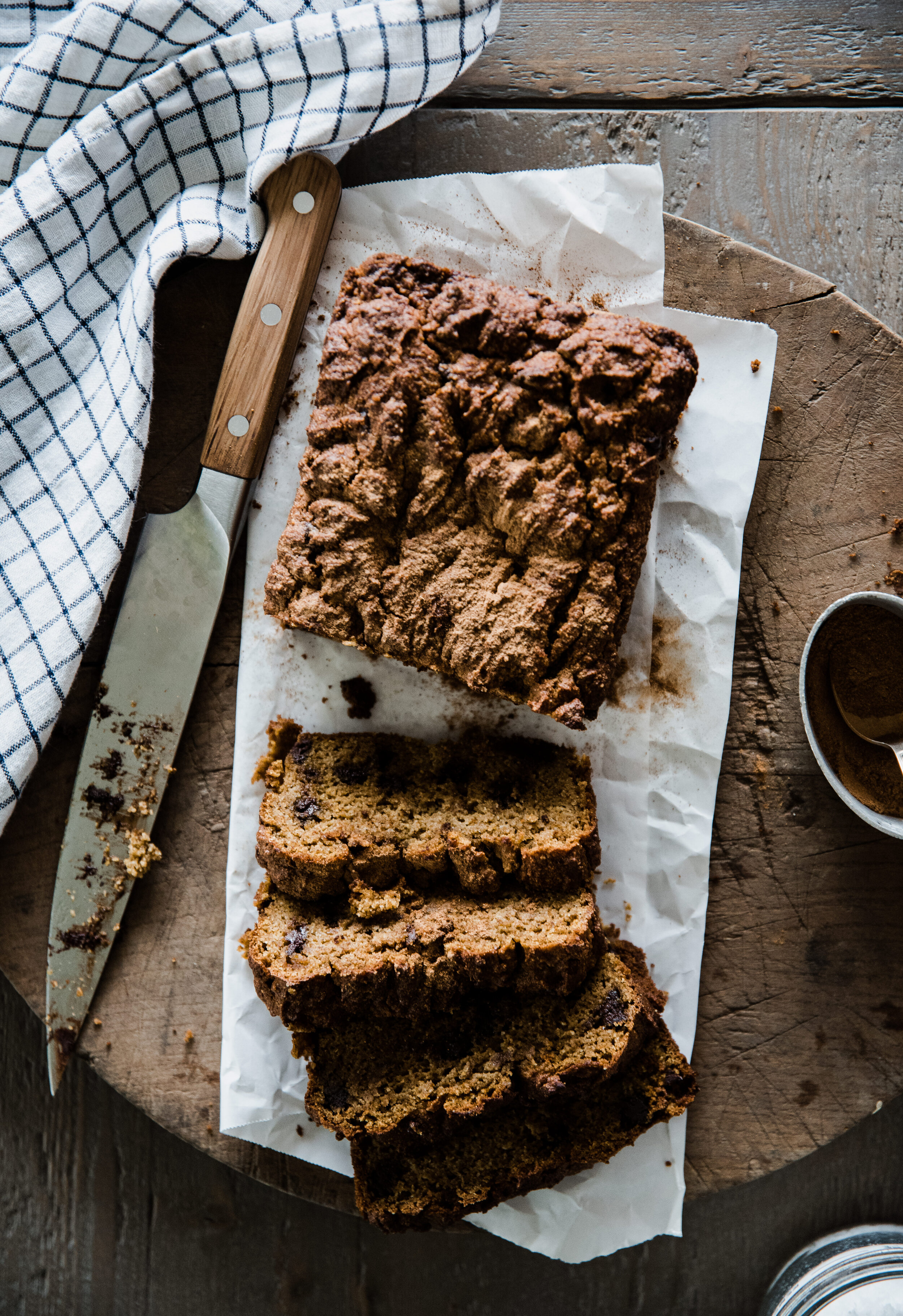 Delicious healthy pumpkin bread baked with chocolate chips and pumpkin pie spice! Low sugar and grain free pumpkin bread recipe. #pumpkinbread #pumpkinspice #pumpkinrecipe