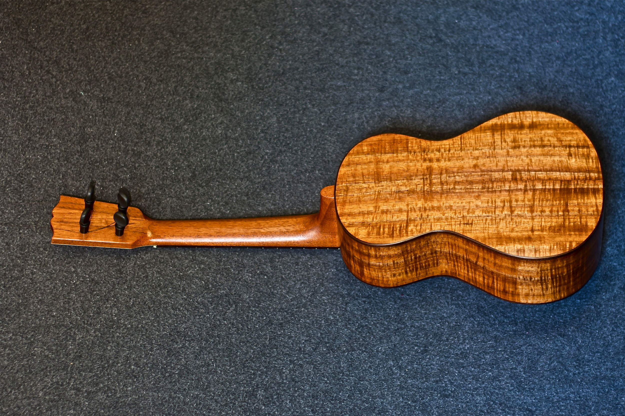 Peghed tuners on a all Koa tenor.