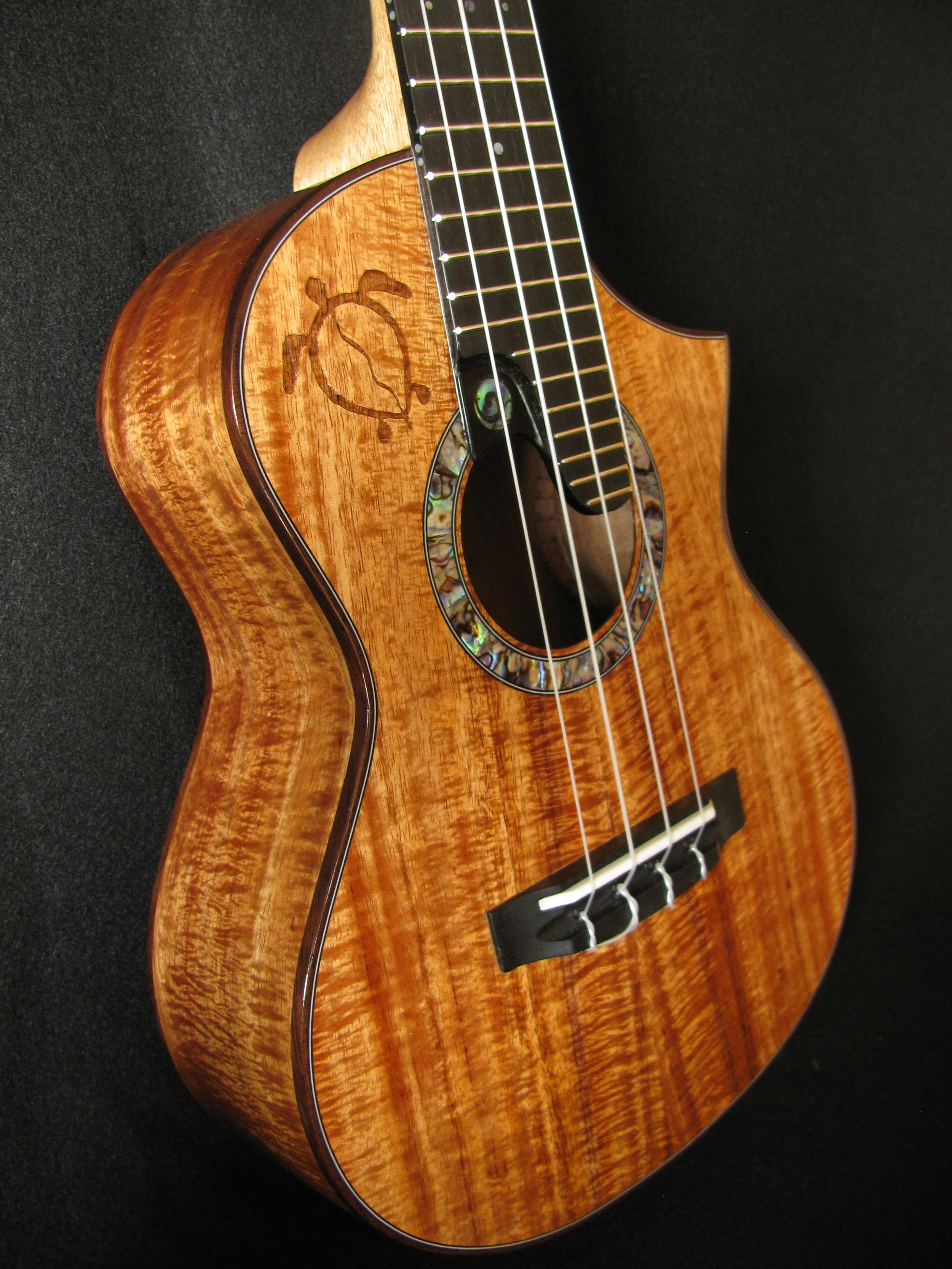 Extended Fretboard with inlayed logo and engraved Honu, on a all Koa tenor