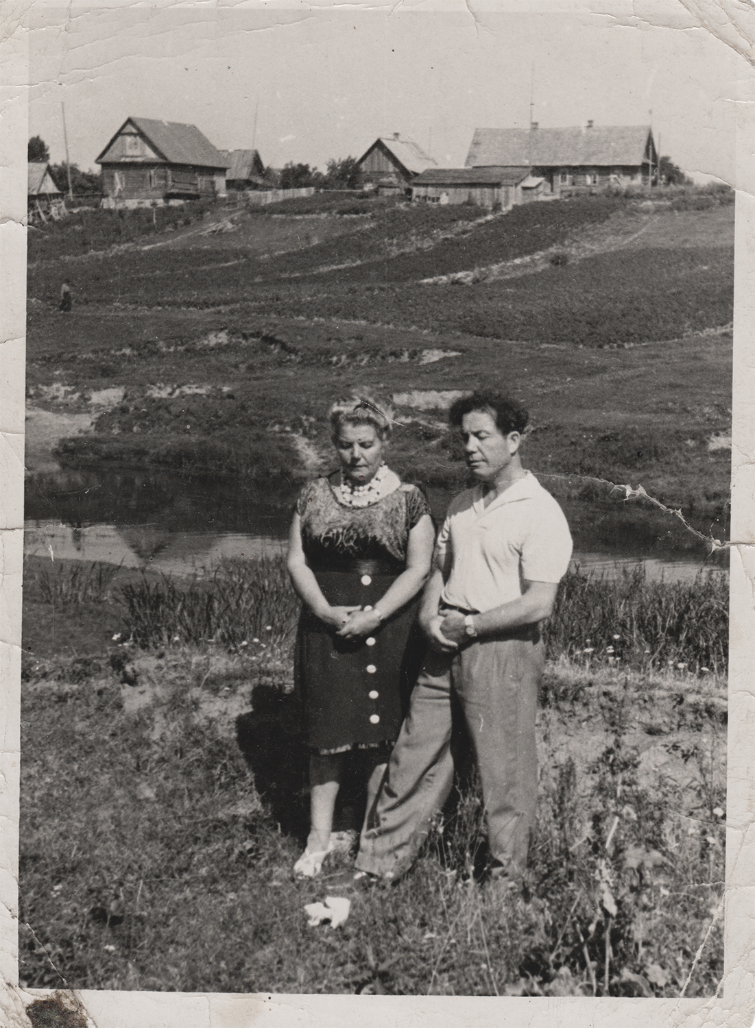 Sverdlov with his sister, standing in front of the site where the Jews of Sharkovchina were murdered.