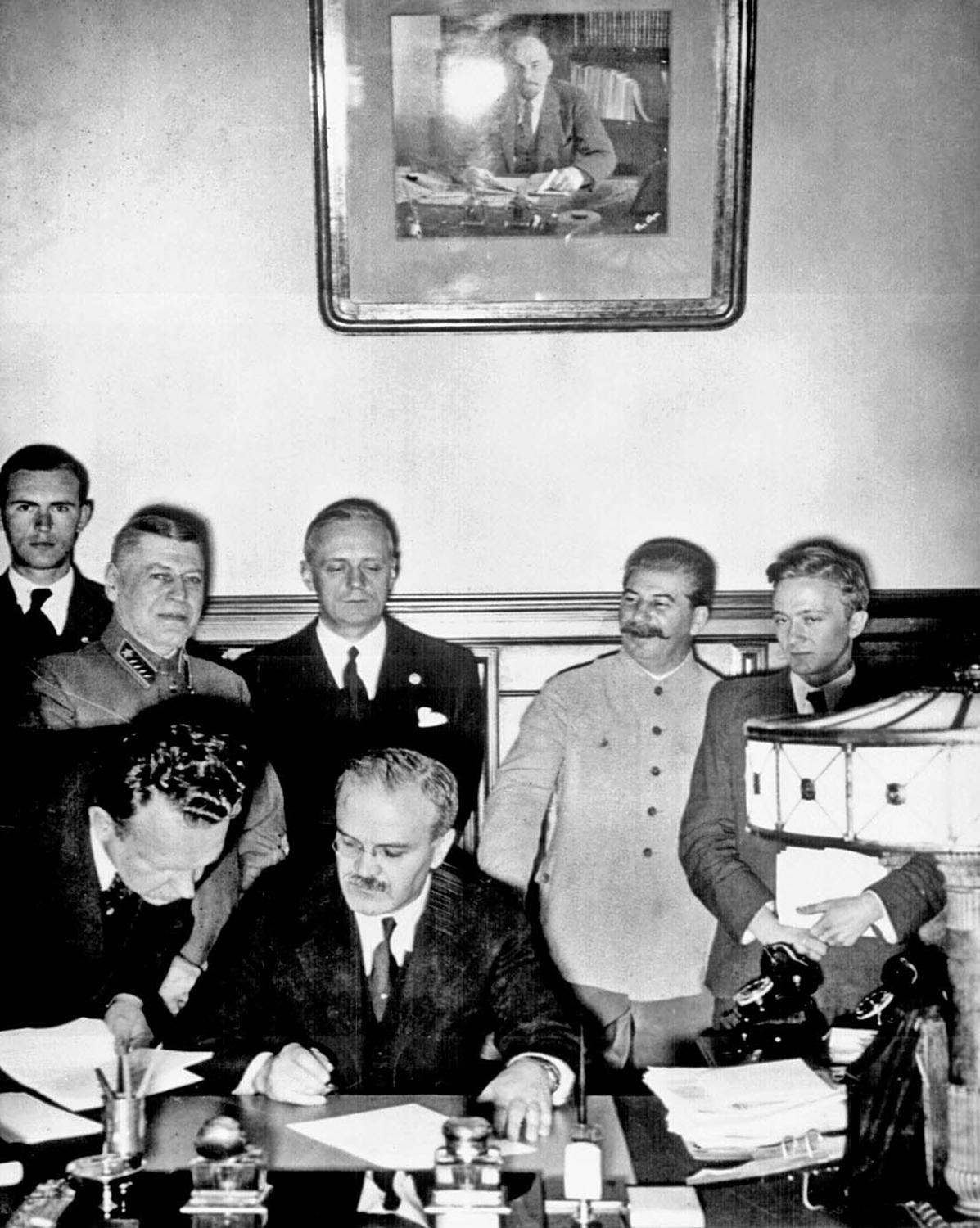 Soviet Foreign Minister Vyacheslav Molotov signs pact in Moscow. August 23, 1939.  Photographer unknown, NARA.