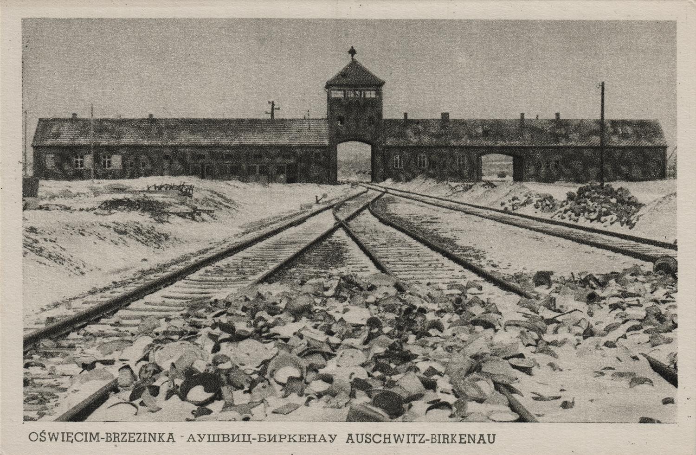 """""""Gate of death."""" Auschwitz-Birkenau, undated. Postcard."""