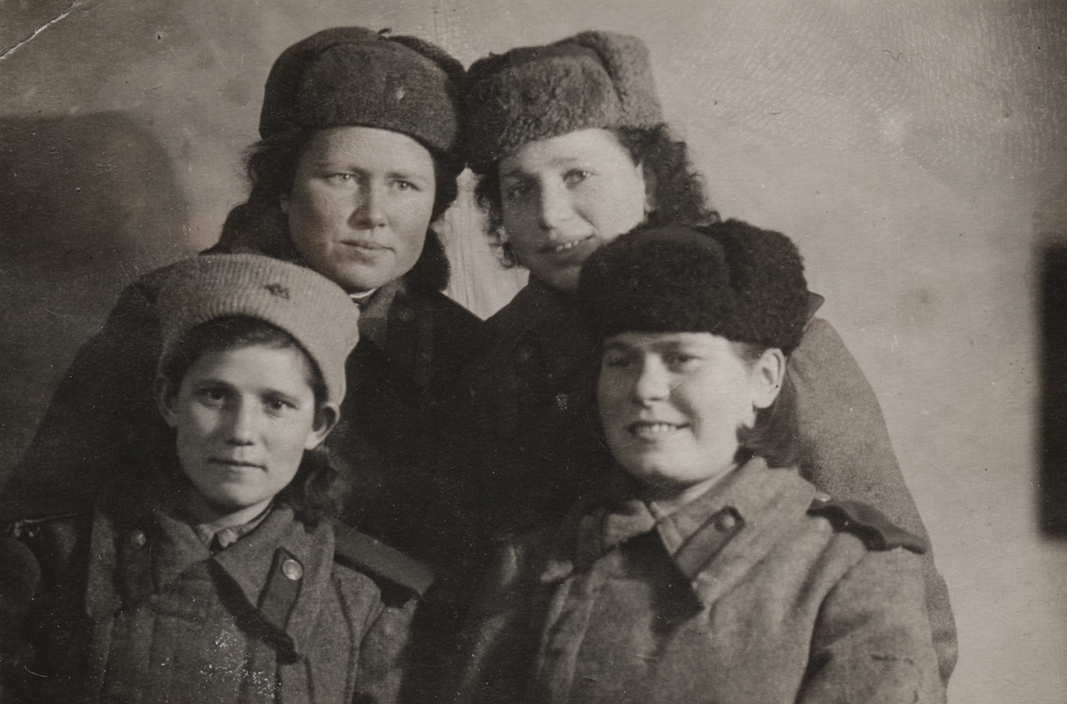 """Raisa Brook, top right, sent photo to her parents from the front. On the back: """"… combat friends. If the enemy comes at us, we'll greet him with shrapnel. January 15, 1944."""