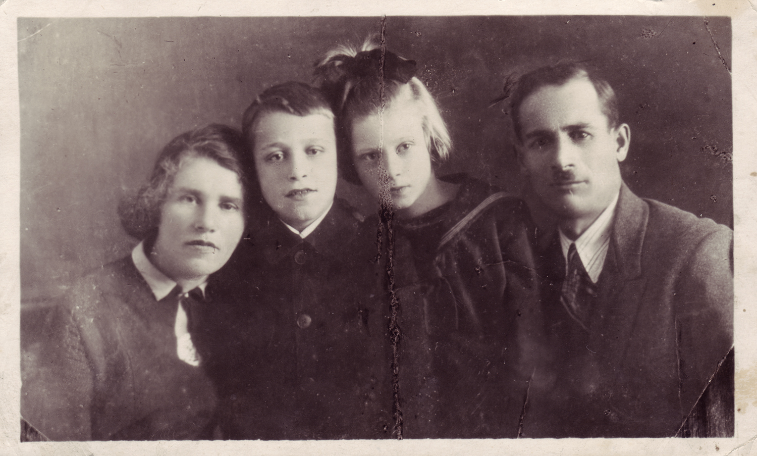 Mikhail Boguslavsky (second from the left) with his mother Rakhil, father Shaya, and sister. Dniepropetrovsk, Ukraine. 1935.