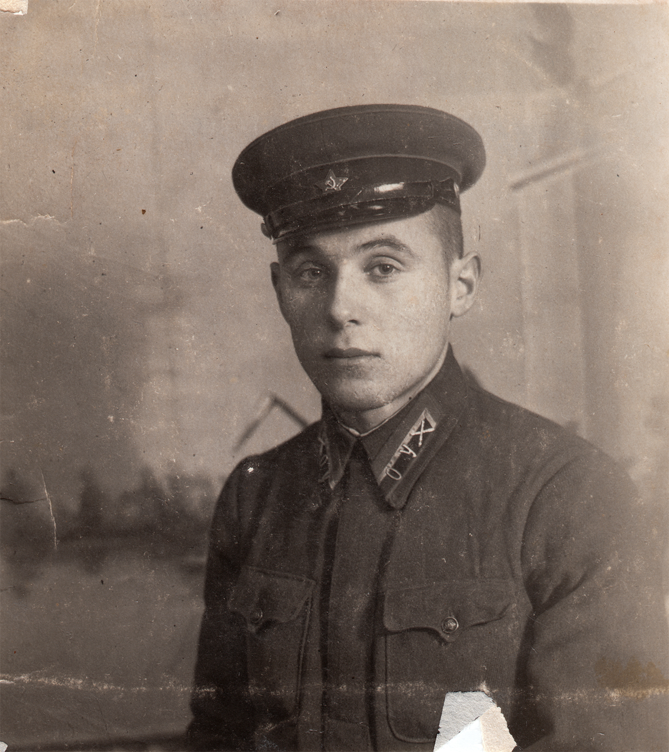 "The photograph that cadet Stolyarsky sent to his parents. Inscription on reverse, ""A moment to remember, to my dear dad and mom, from your son. Odessa Artillery School. Sukholuzhzhya [Ukraine]. January 9, 1942"