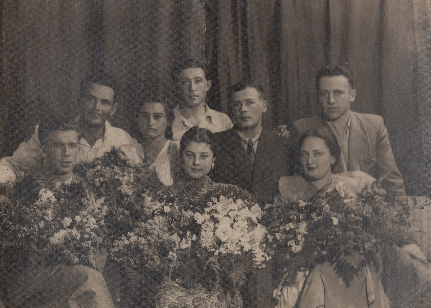 Yankelevich's wedding photograph. His bride, Larisa, is in 1st row, middle; Mark is standing behind her in a dark suit. Kyiv, 1950