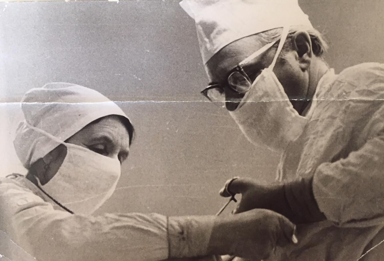 Samson and Dr. Lidia Kornilova performing surgery on Mechislav Polukart, a professional motorcycle racer. Lviv, 1964
