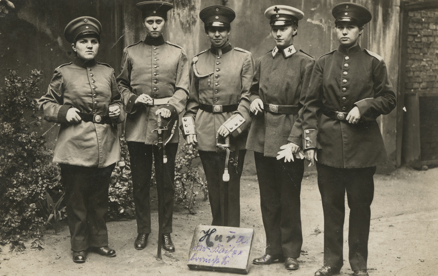 Women dressed in mens military uniforms. 1915