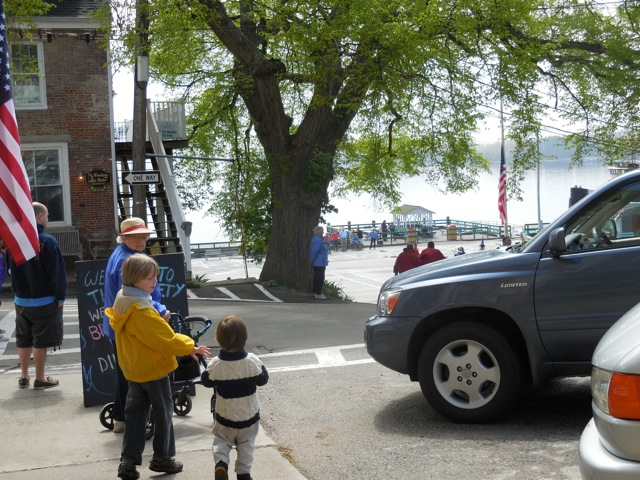 Elias reaches for August's hand to cross into the middle of the road. There's Dottie!