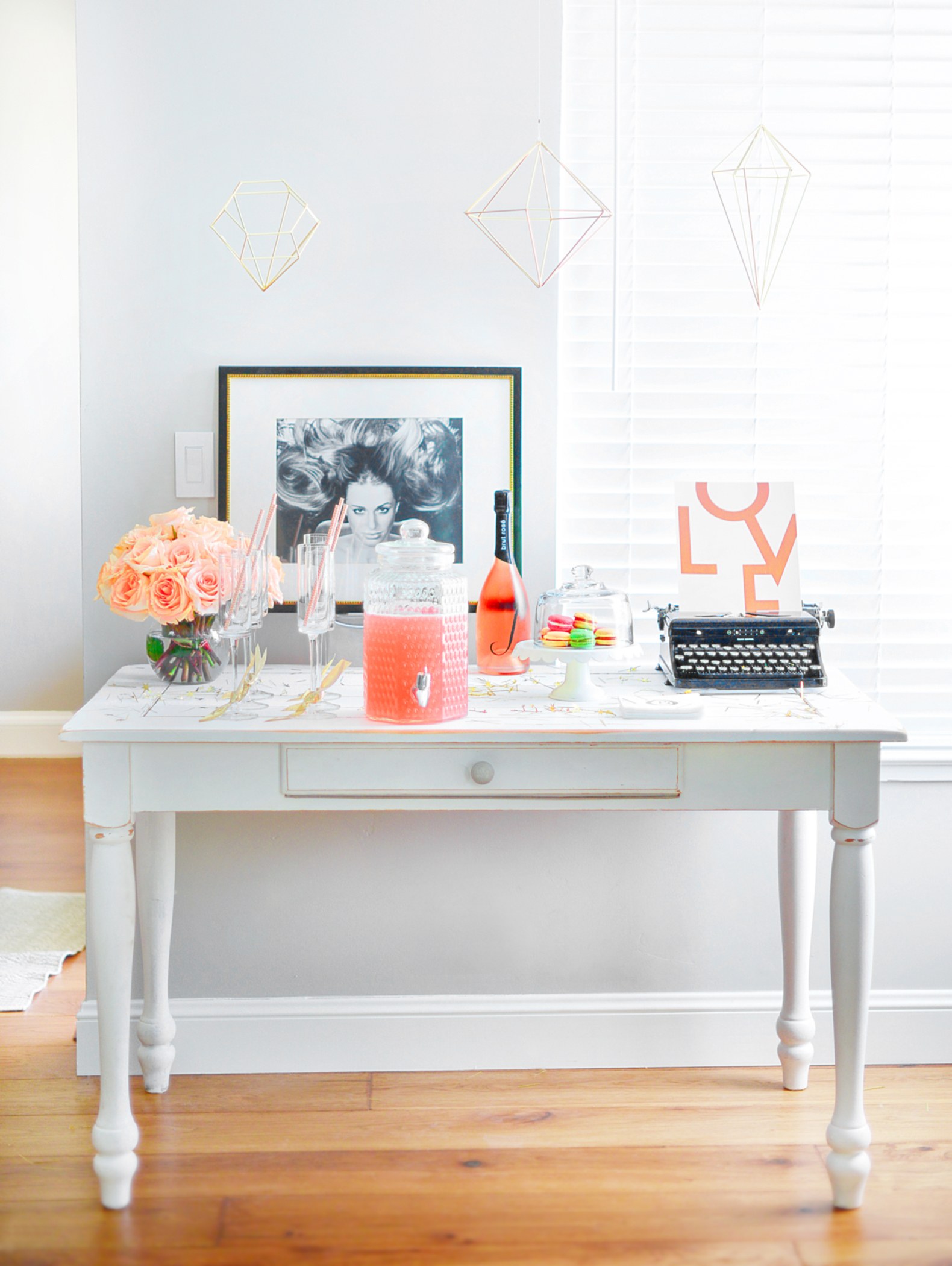 Must haves for a Mimosa Bar; fresh flowers, dessert and pops of gold.  Diamond wall decor found online at  Umbra.Com