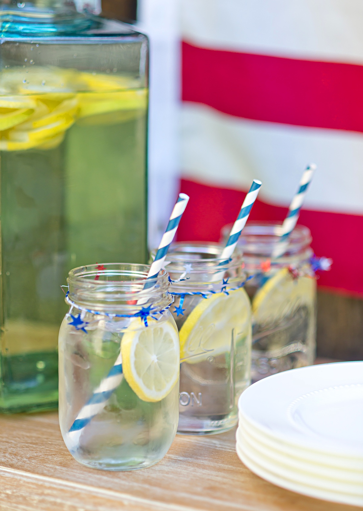 Hydrate your guests with flavored water! Fun star twill and striped straws make for great 4th of July details! #4thofjuly #flavoredwater #decorations