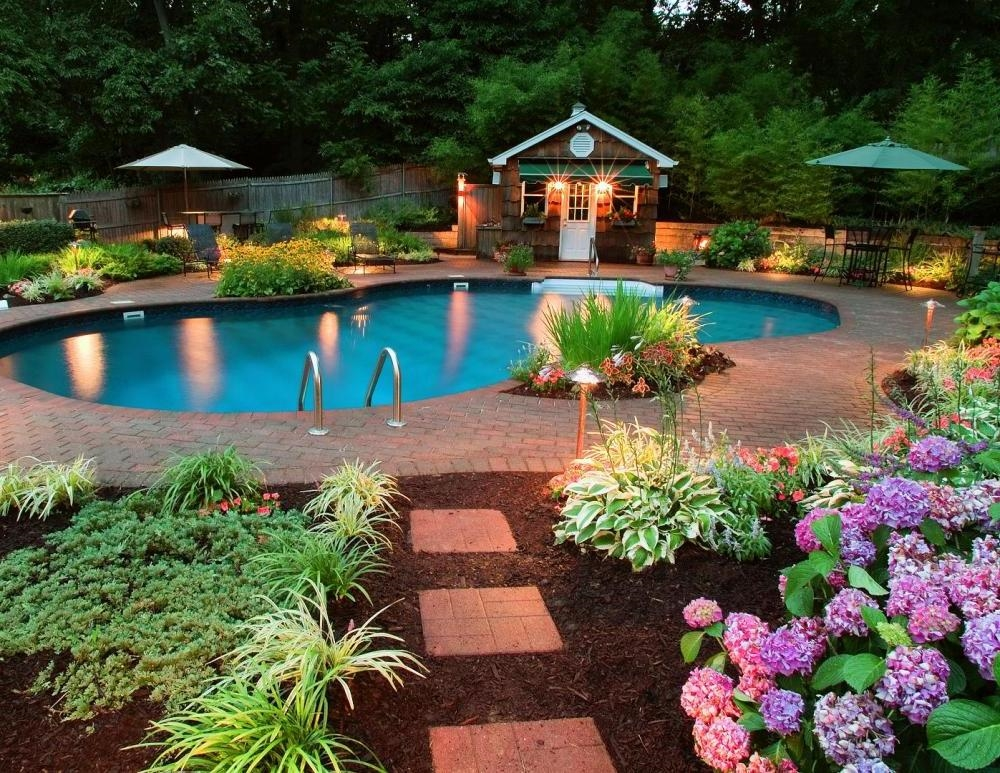 decorating-outdoor-lighting-in-beautiful-garden-near-swimming-pool-in-small-house.jpg