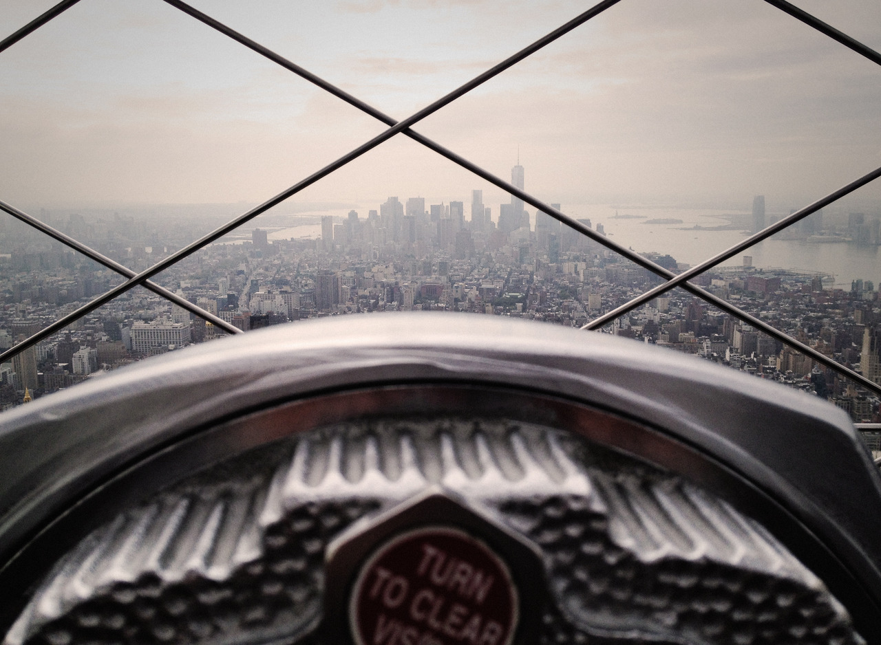 A beautiful shot of New York City, from far up in the clouds. Image via  unsplash .