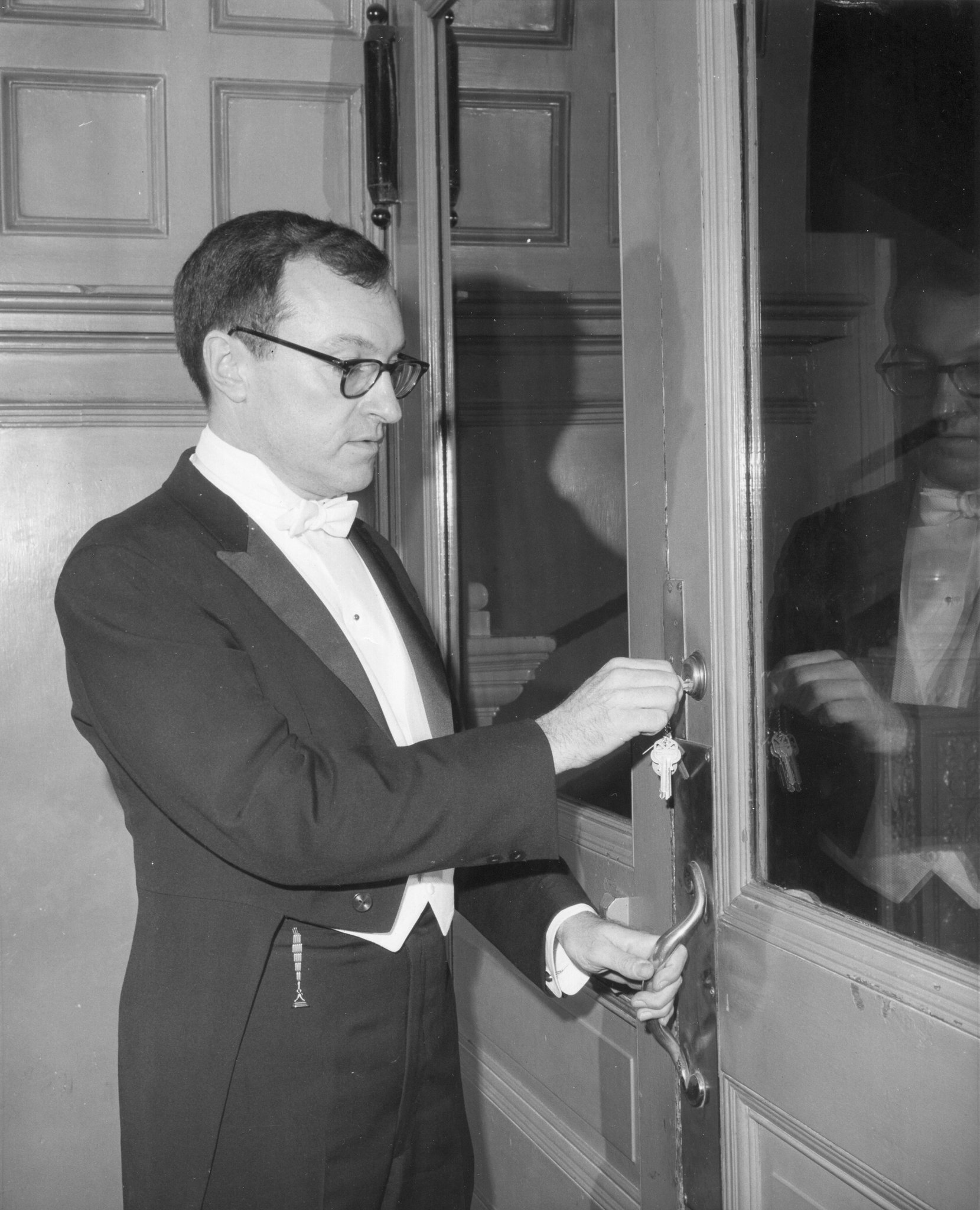 Mr. Hubay locking the old Metropolitan Opera, at Broadway and 39th Street, after a farewell gala in 1966. The company moved north to Lincoln Center, and its previous home was torn down.  Credit via The Metropolitan Opera