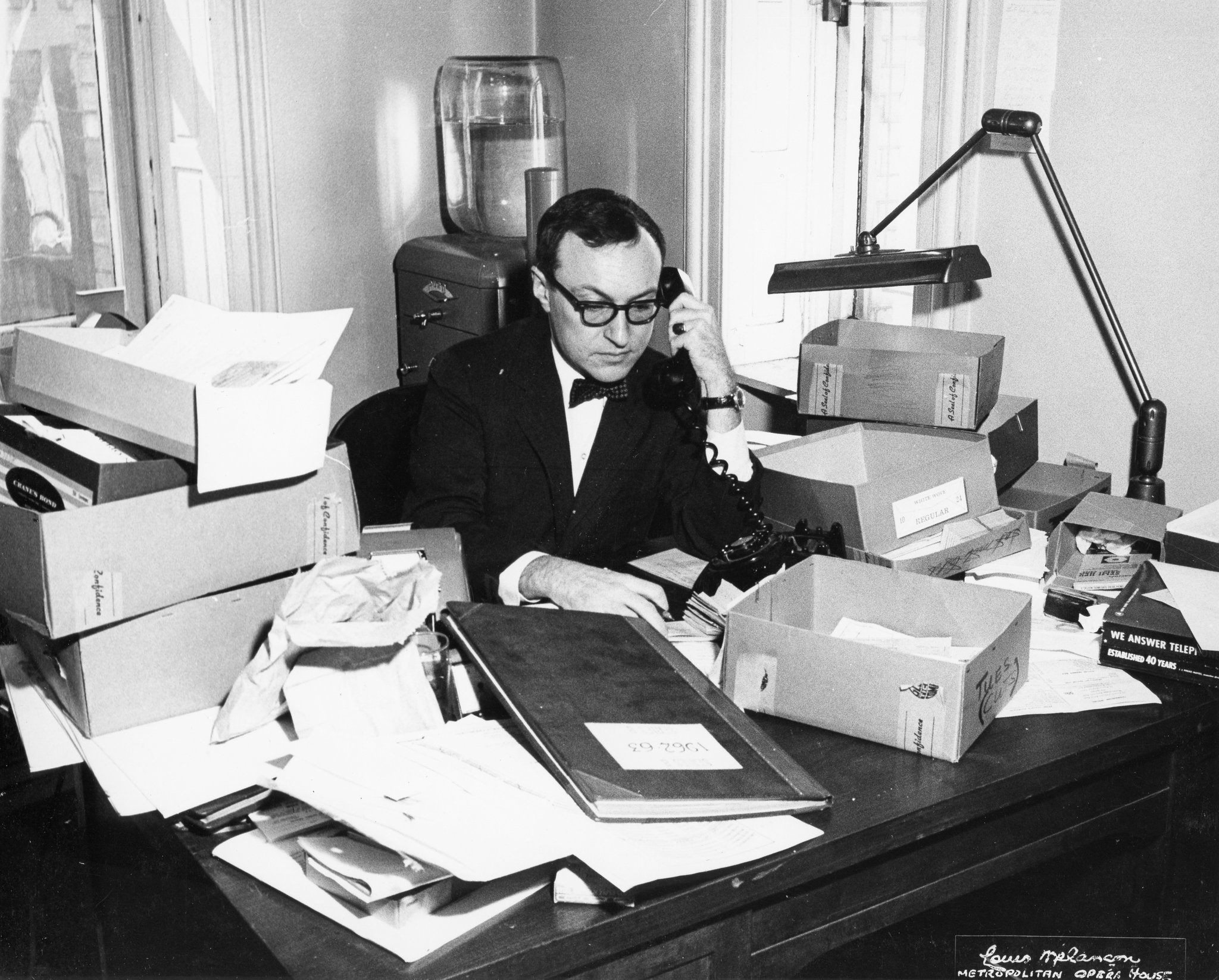 Alfred Hubay at work in the 1960s. His long career as an usher, house manager and box office chief gave him the ability to predict houses with uncanny precision. Credit Louis Melancon/The Metropolitan Opera