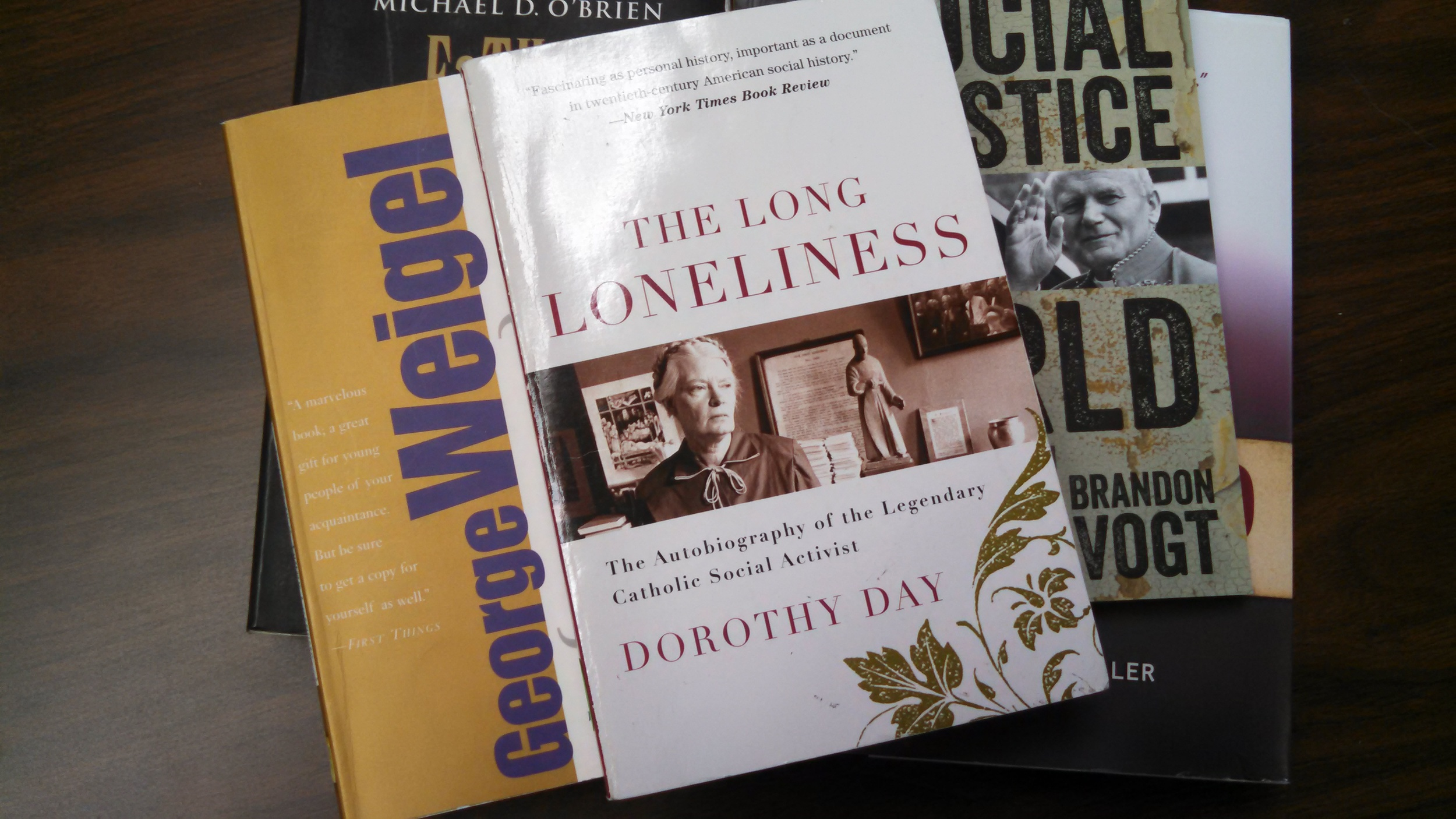 Some of our library books that influenced me - including The Long Loneliness.