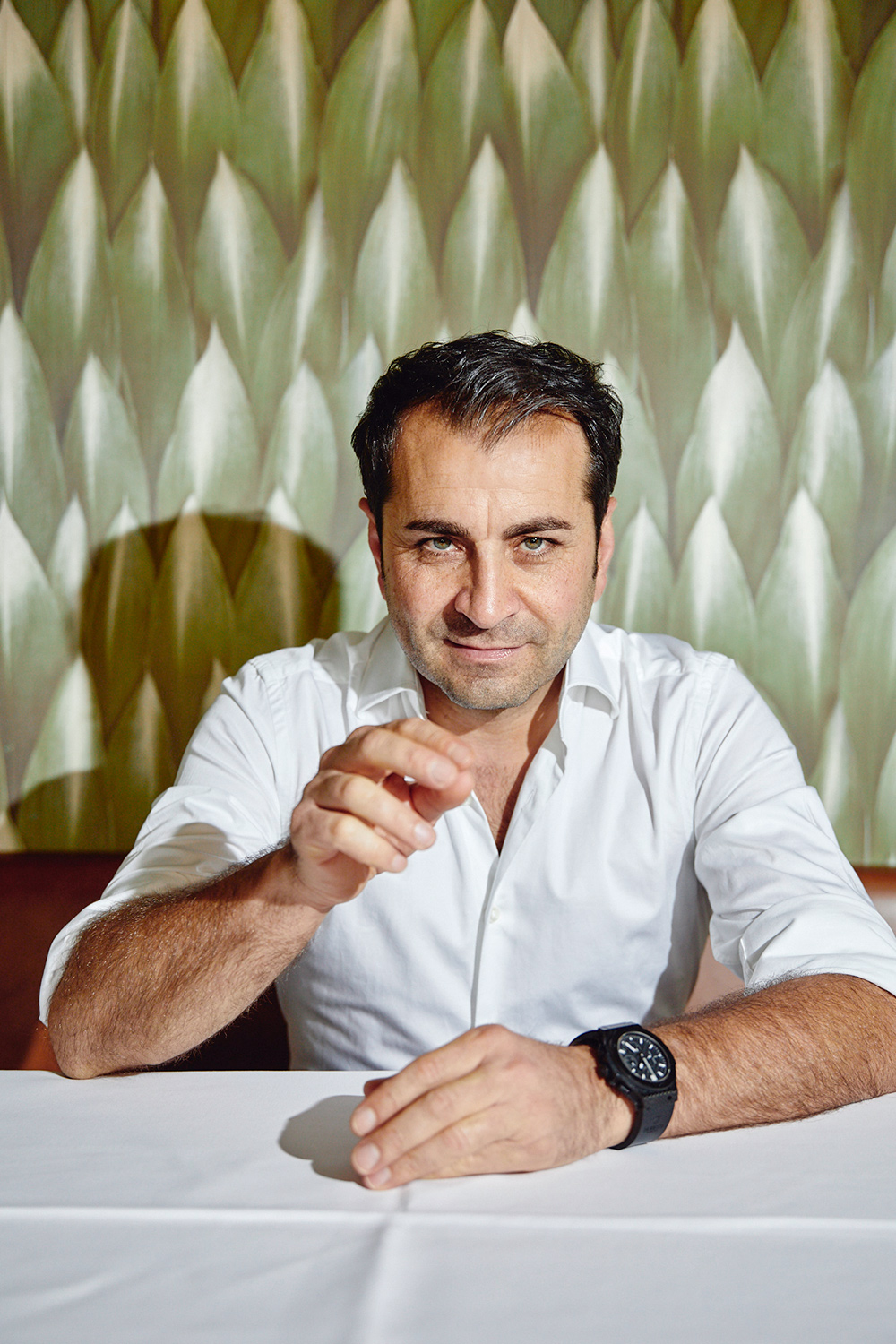 Cook Ali Güngörmüs posing in his restaurant Pageou and outdoor for his new book and cover published at Rowohlt