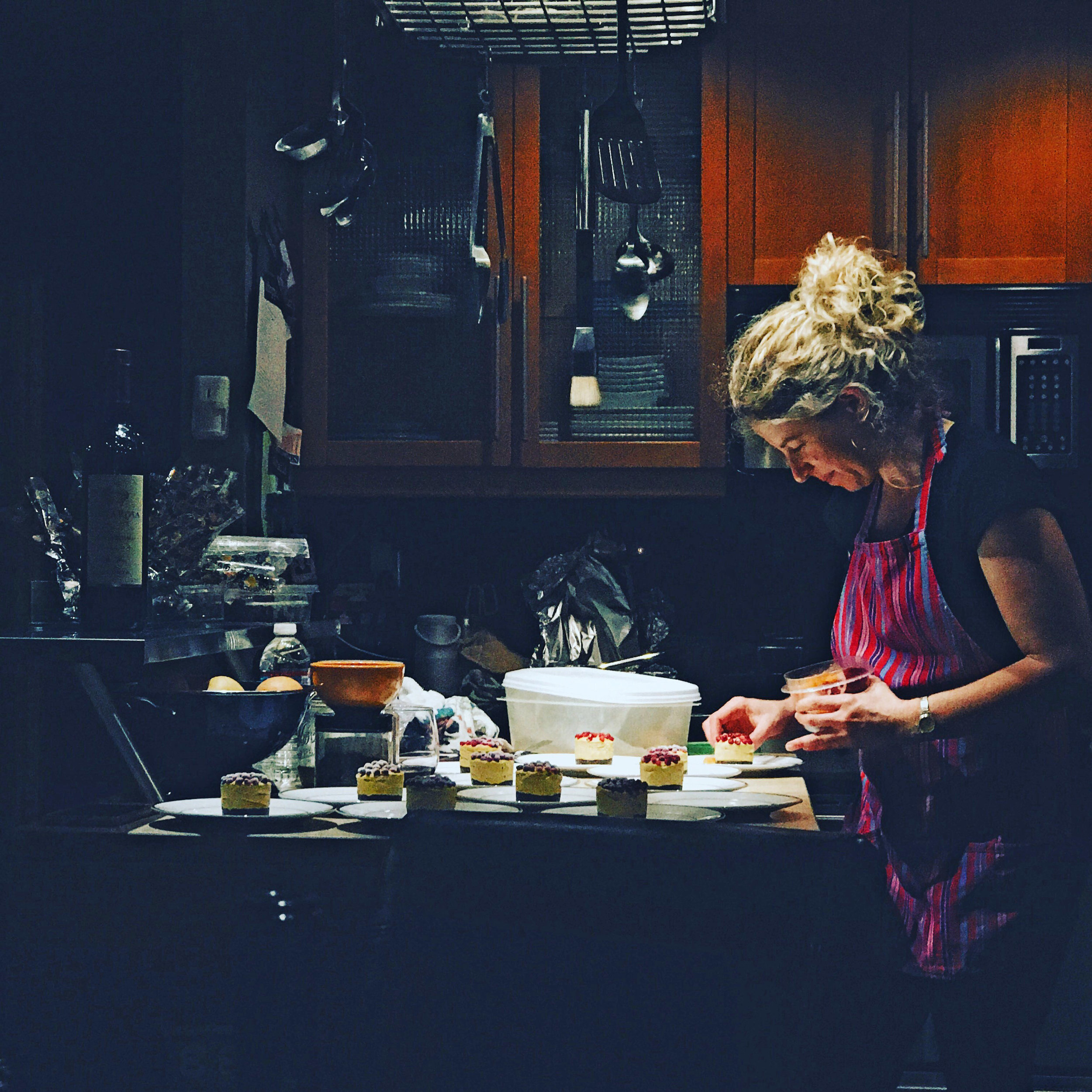Jennifer from FoodSoulutions Cooking in Kitchen.jpg