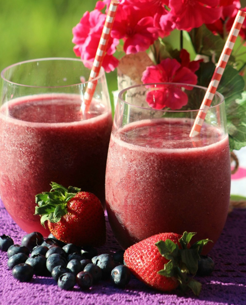 """Easy Berry Green Smoothie  by  Dancing Through the Rain   """"This easy Berry Green Smoothie is the one that has worked best for my family. My daughter likes it just as it is and my son prefers it with no blueberries, but what is most important is that no one notices the kale."""" - Dancing Through the Rain"""