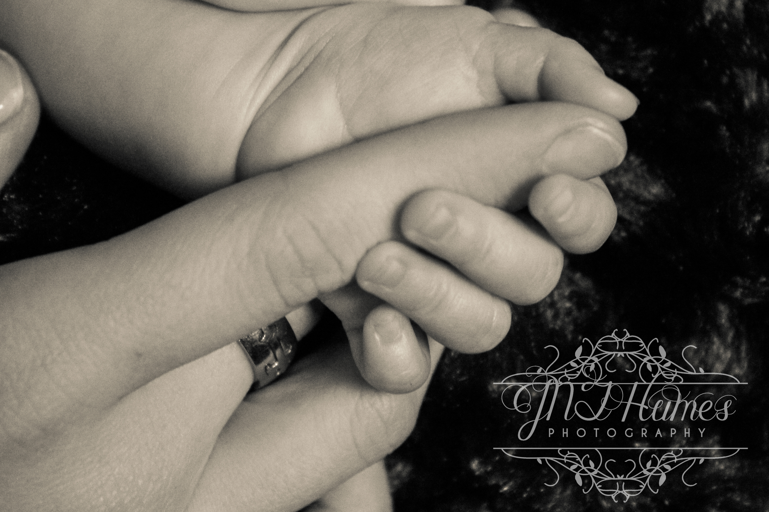 Little Lilly holding her Mommy's hand. Such a precious photo.