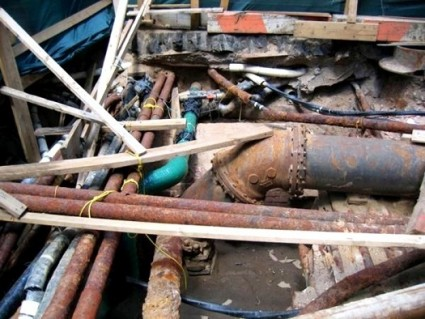 typical crisscross corroded pipes carrying municipal waste and drinking water underground. out of sight, out of mind. ignorance isn't bliss.
