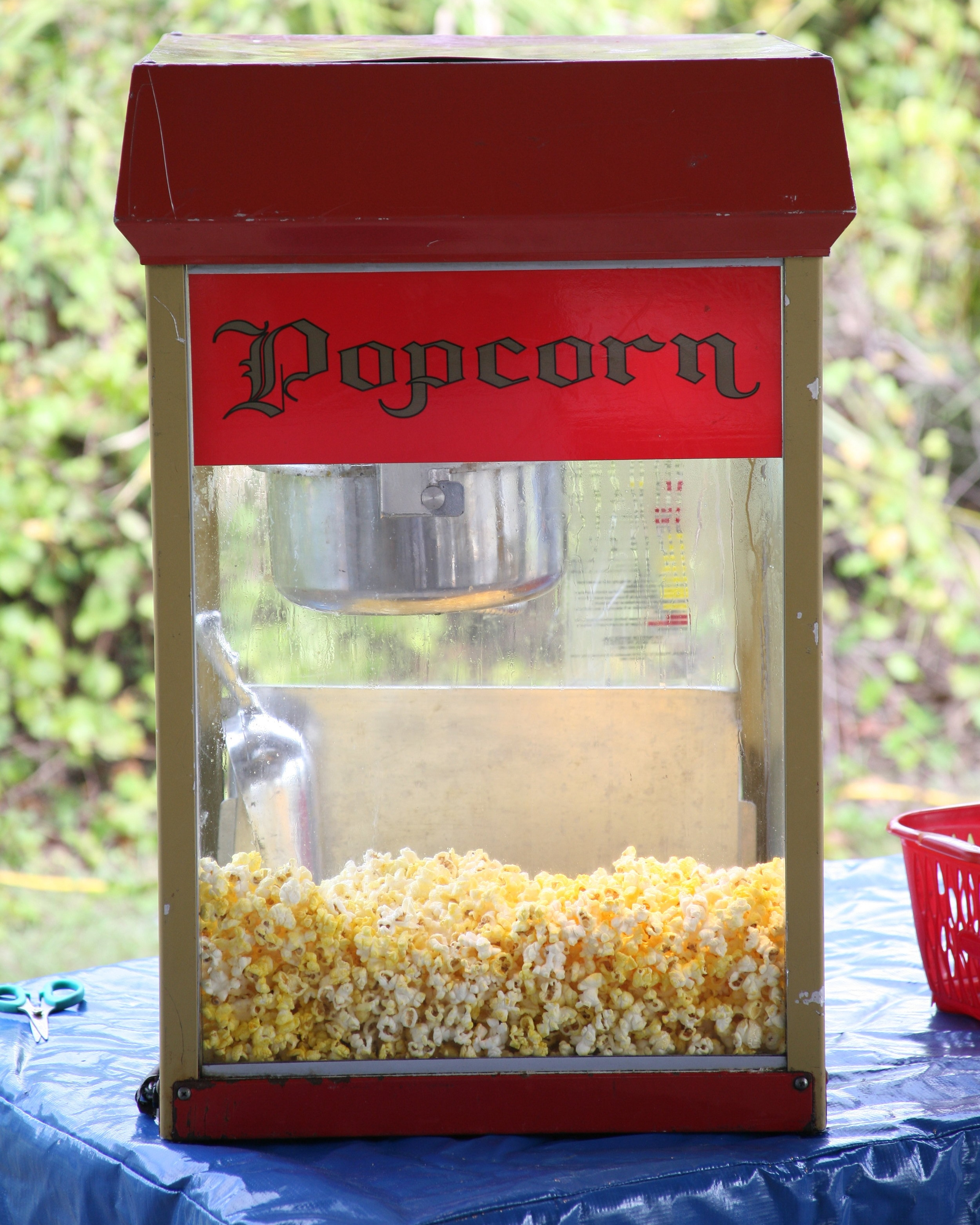 8oz Popcorn Popper with 50 servings.  $55.00