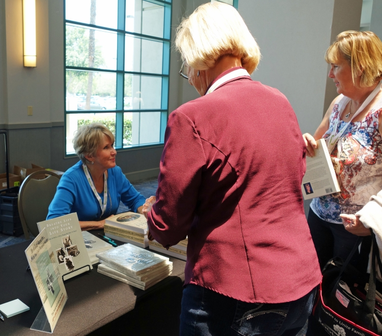 Signing books after speaking at Jamboree, the Southern California Genealogy Society's BIG annual conference