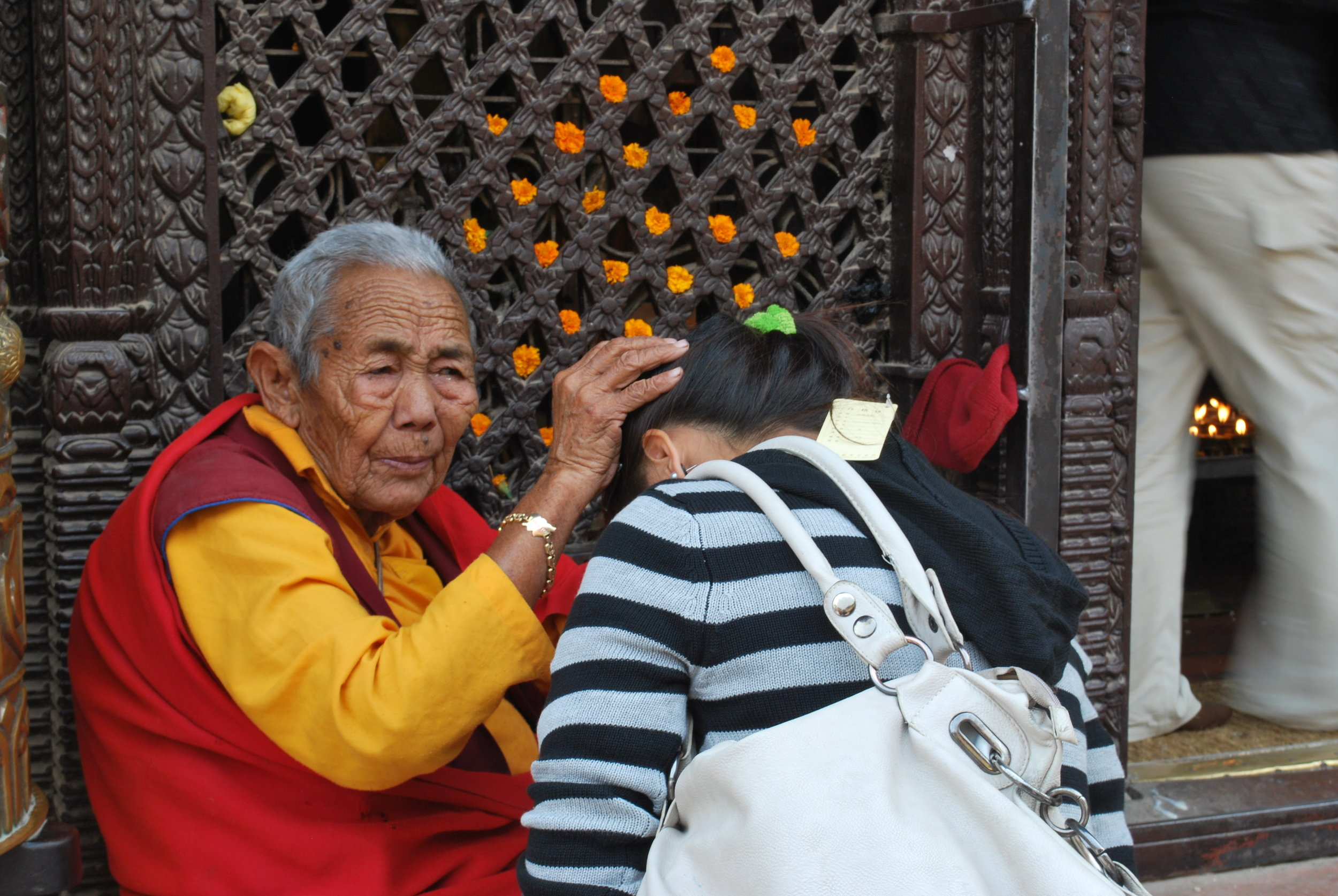 Elder blessing at Bodenath   Photo by Amy Hahn
