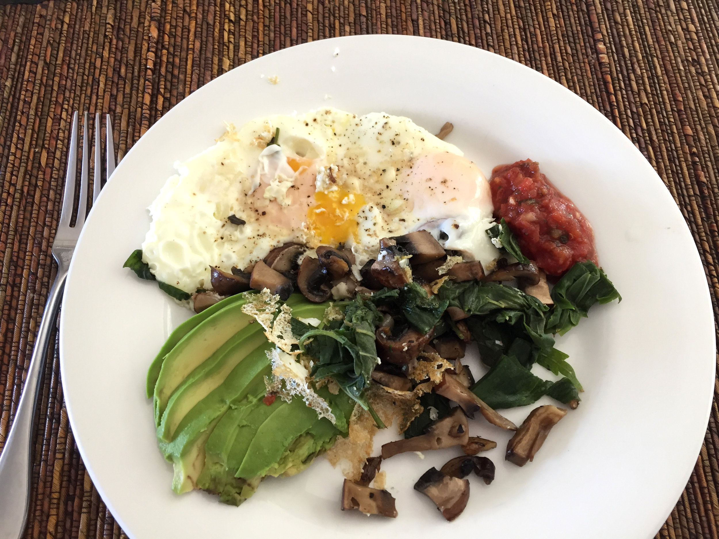 Sautéed stinging nettle with mushroom, egg, avocado and salsa.