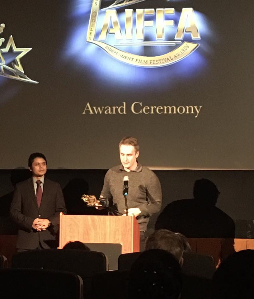 Director Shawn Lebert recieving the Best Picture award.