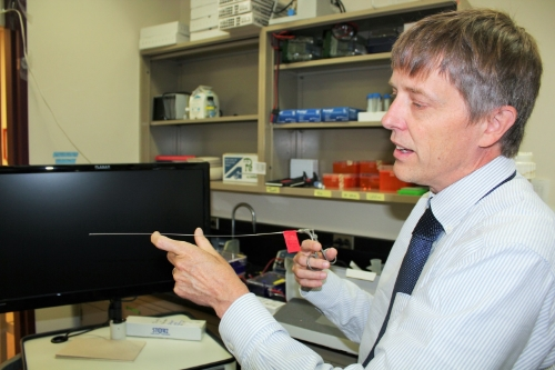 Dr. Tim Starr, Principal Investigator at the Starr Lab, displays Minnesota's first mouse colonoscopy tools